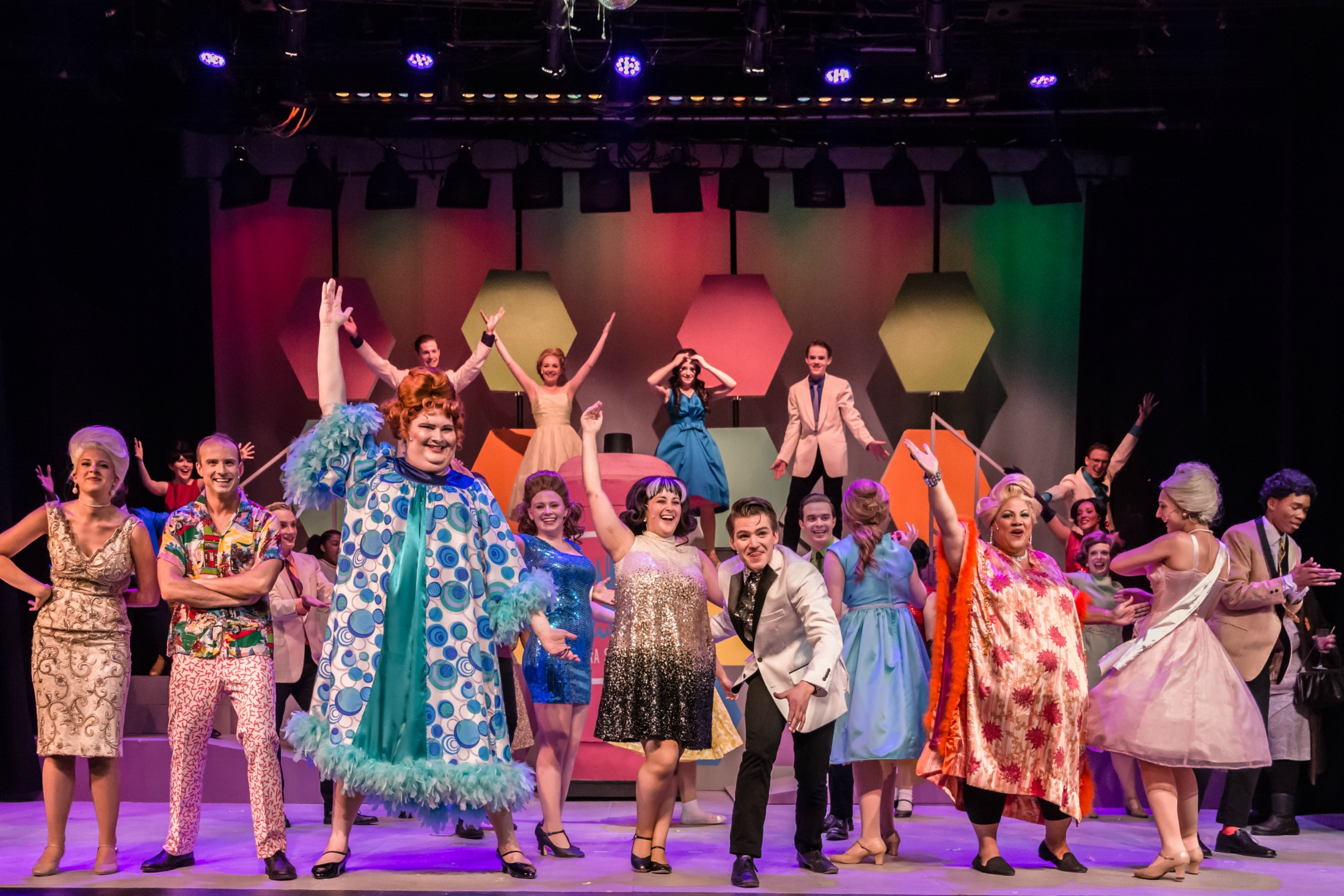"""Tracy (Emma Borkowski), and Link (Daniel Persino), center, lead """"You Can't Stop the Beat"""" along with, from left, front, Velma (Megan Rose Miller), Wilbur (Keith R. Smith), Edna (Noah Maguire), Penny (Amber Weissen), Motormouth Maybelle (Sharon Tyler) and Amber (Hope Riesterer), the finale of Sunset's """"Hairspray."""""""