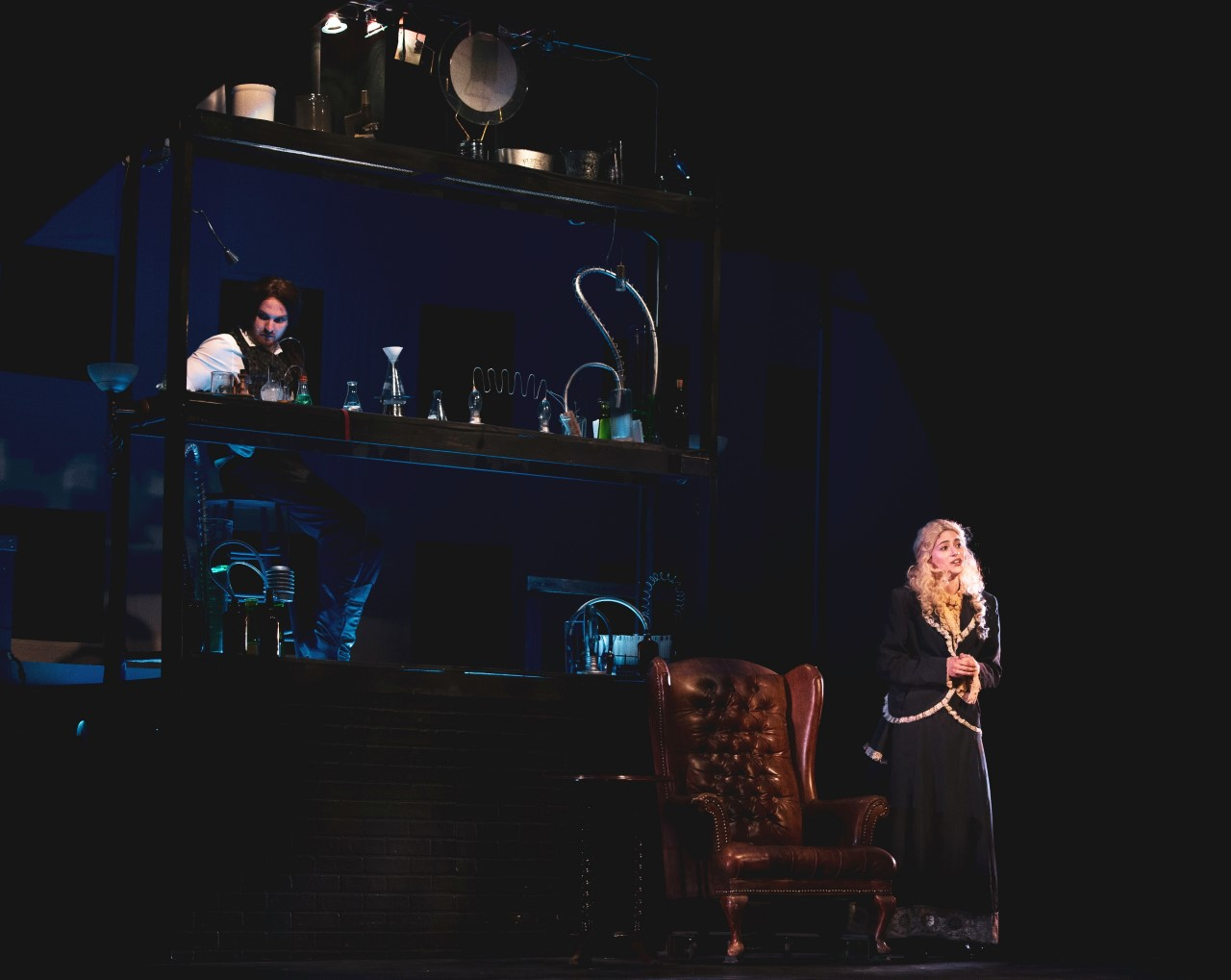 """Dr. Jekyll (Eric Bergendahl) works in his laboratory while his betrothed Emma (Rachel Mauney) sings """"Once Upon a Dream"""" in the West Allis Players """"Jekyll and Hyde."""""""