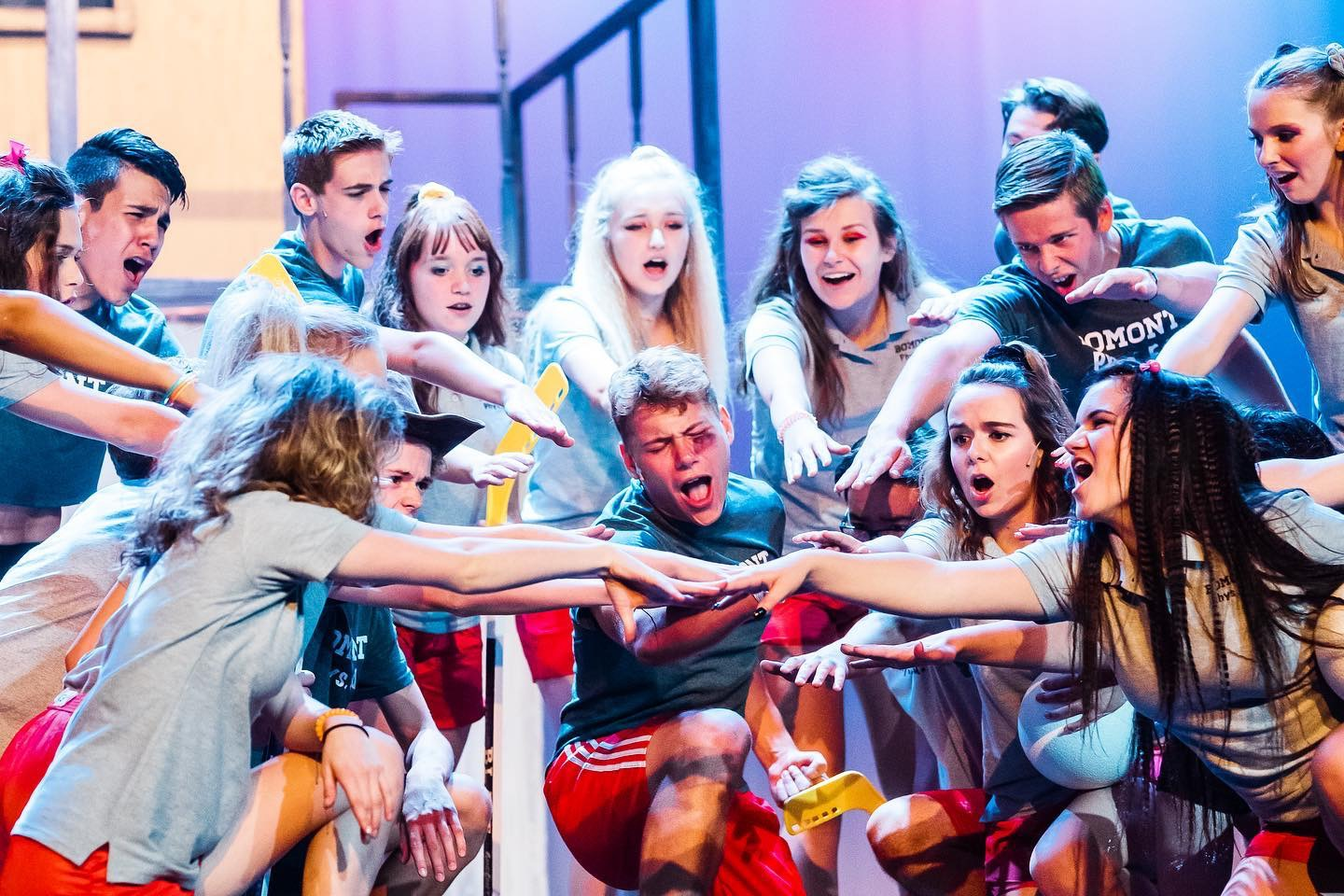"""Niko Dulin (Ren), center, gets support from his classmates after being beat up in a scene from Sudbrink Performance Academy's """"Footloose."""""""