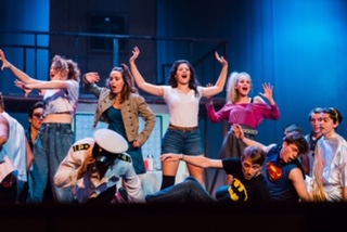 """Ariel (Grace Hubler), center, leads the ladies in """"Holding Out for a Hero."""""""