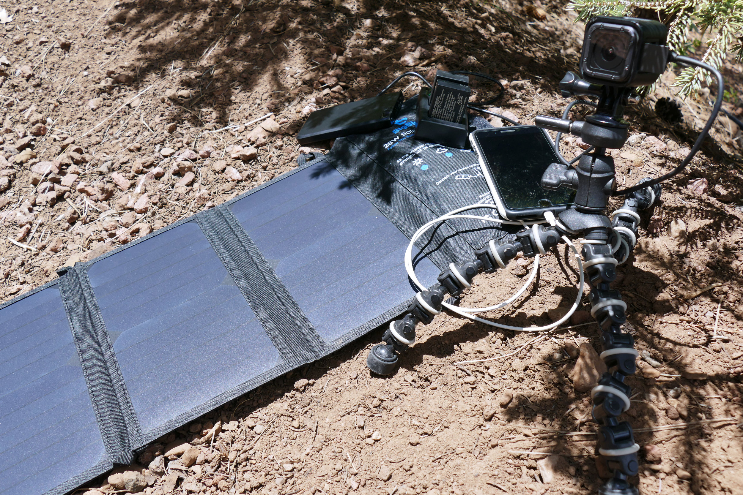 One charger and some sunshine, and I am refueling my phone, 2 main camera batteries, and the GoPro…I love technology!