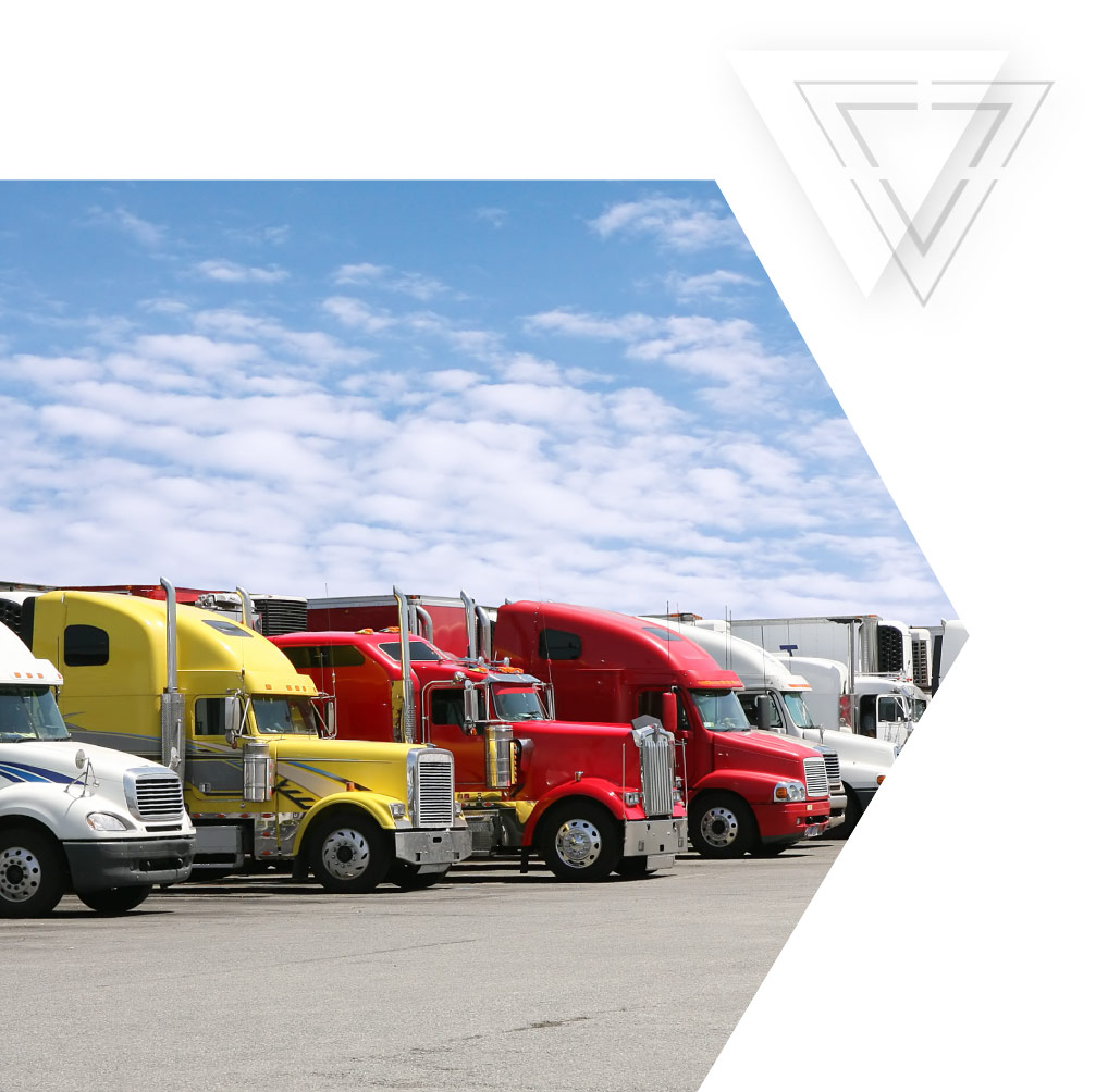 photo--graphic--cutout--chevron-right-triangles-semi-trucks-parked.jpg