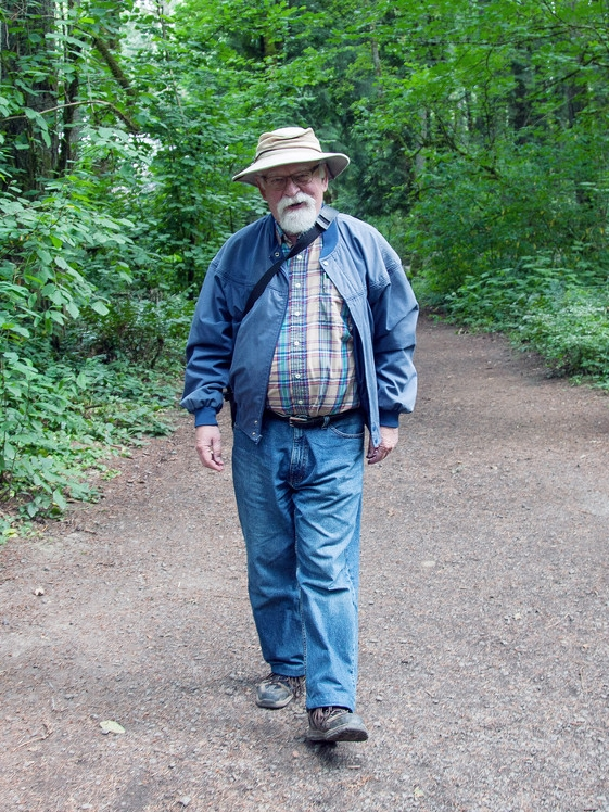 Bruce Rottink walking along Old Main Trail
