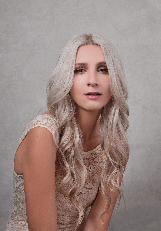 vanity fair style portrait of long hair blonde girl in lace dress