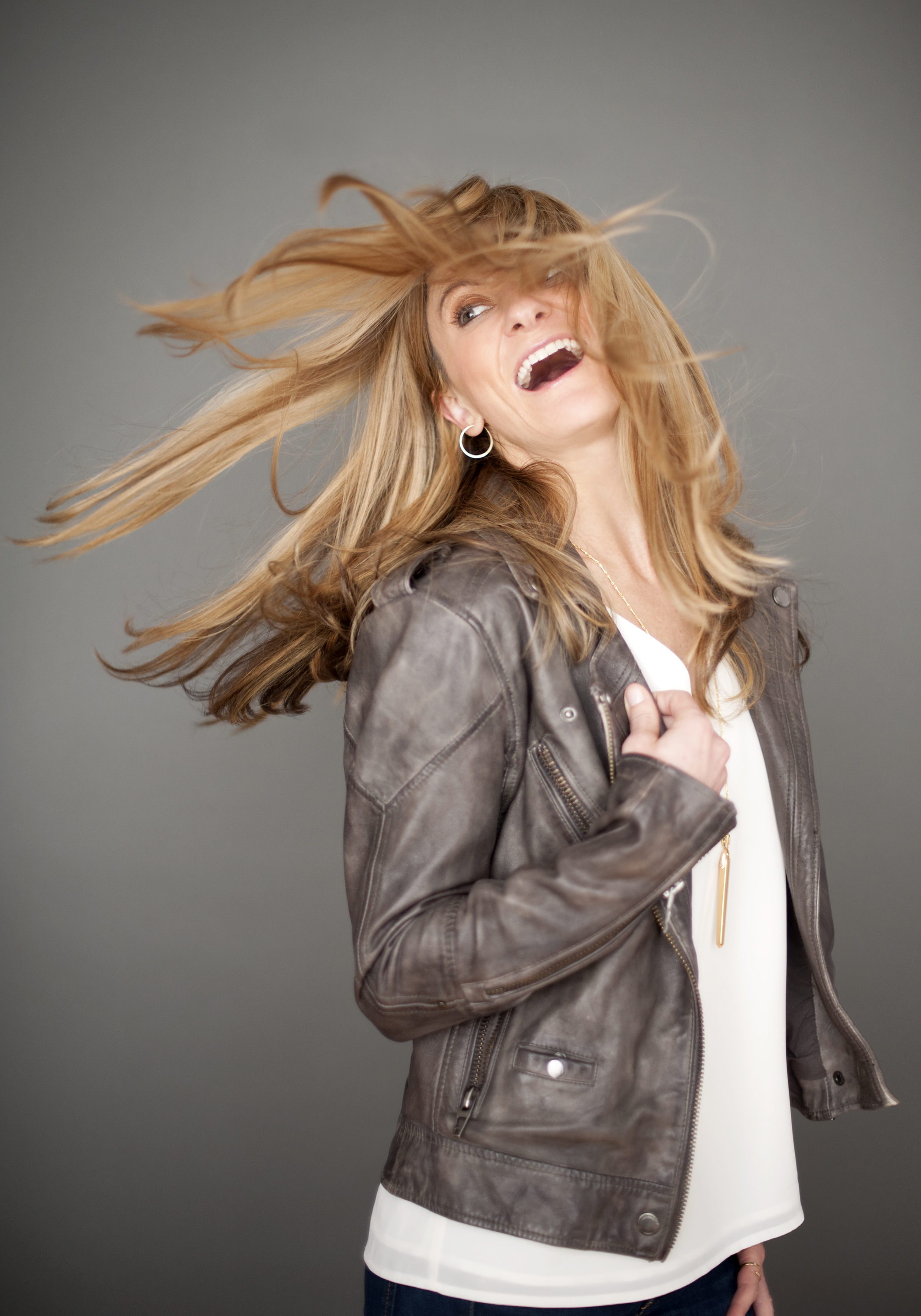 hair flip movement in brown leather jacket