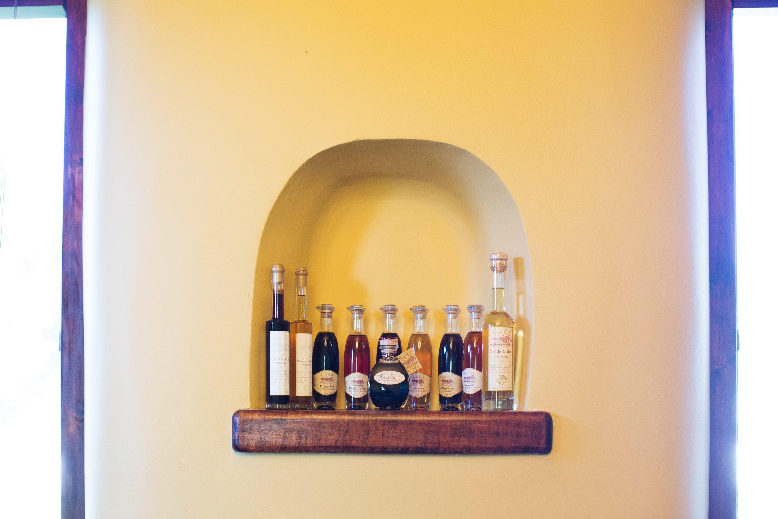 Vinegars displayed in a custom niche