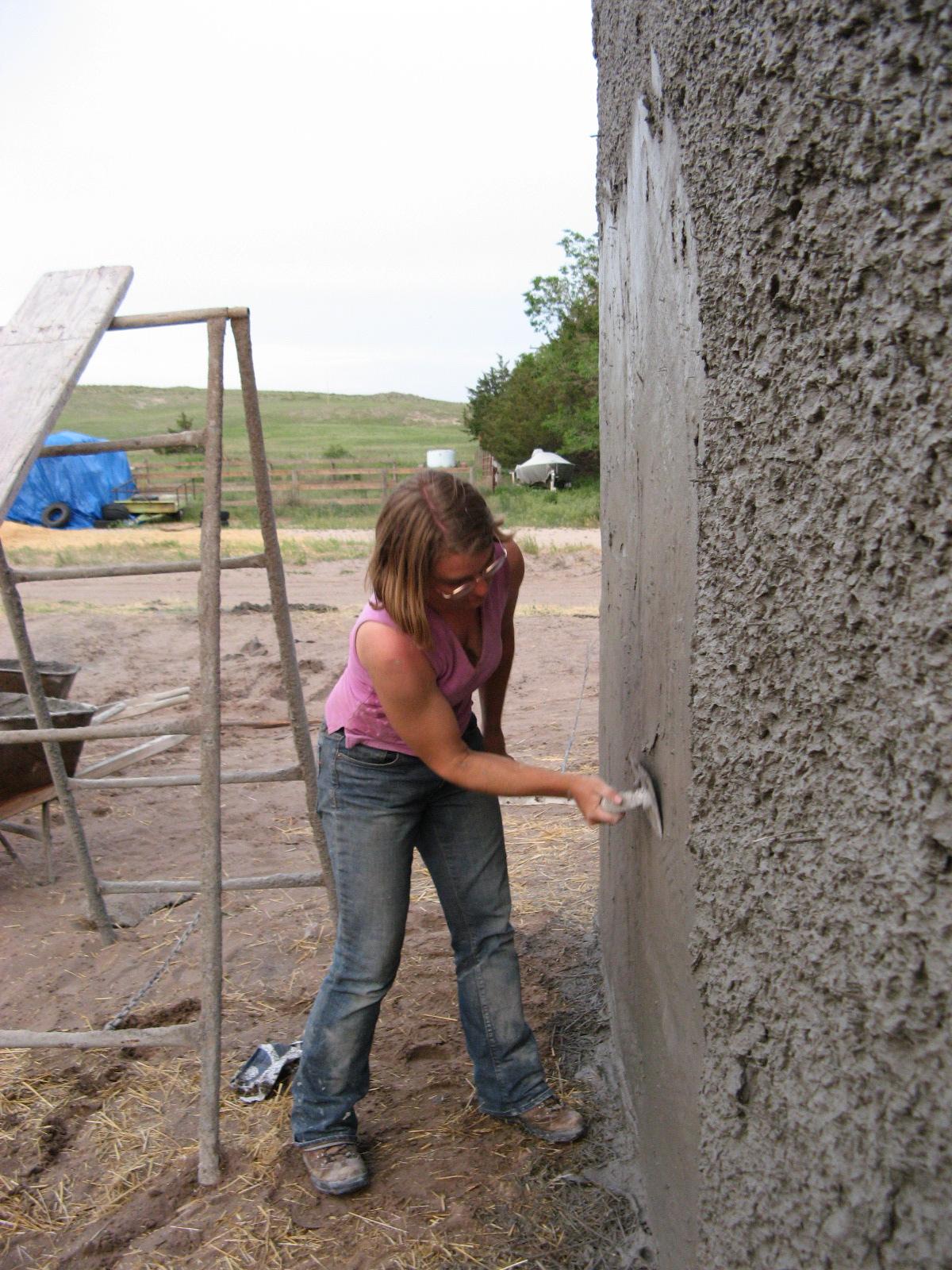 Emily troweling stucco