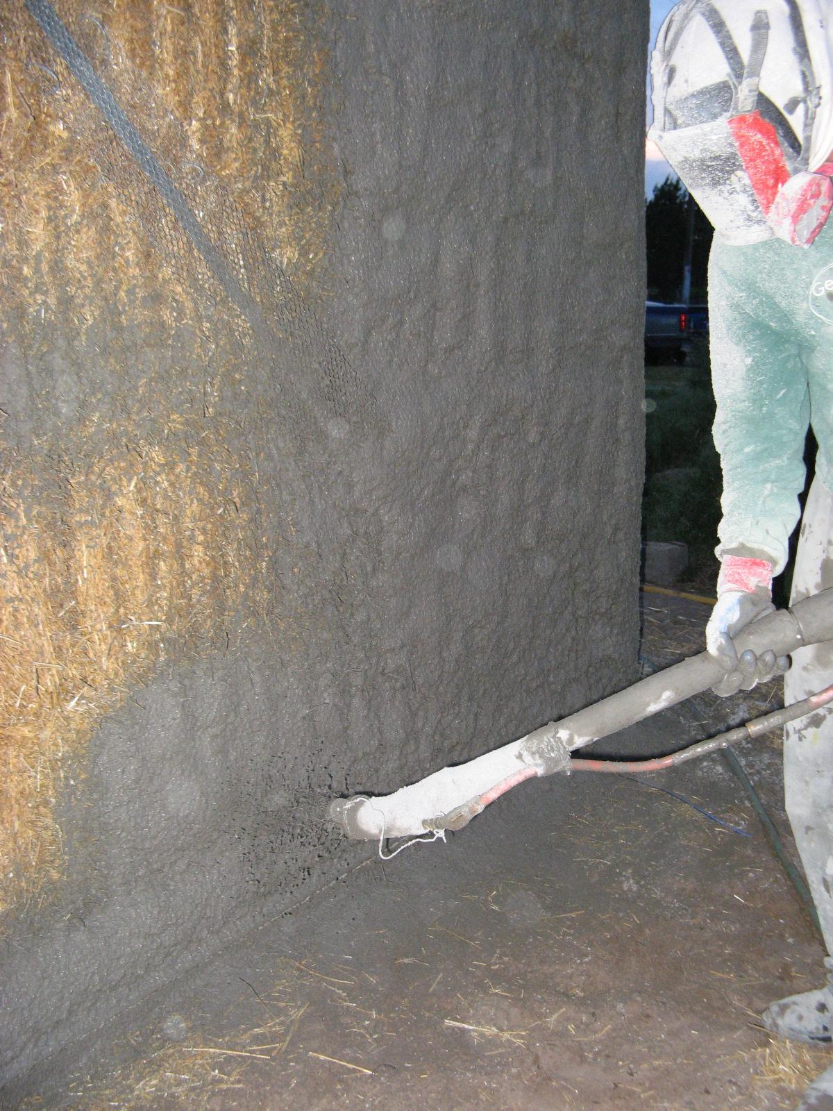 Tony spraying stucco