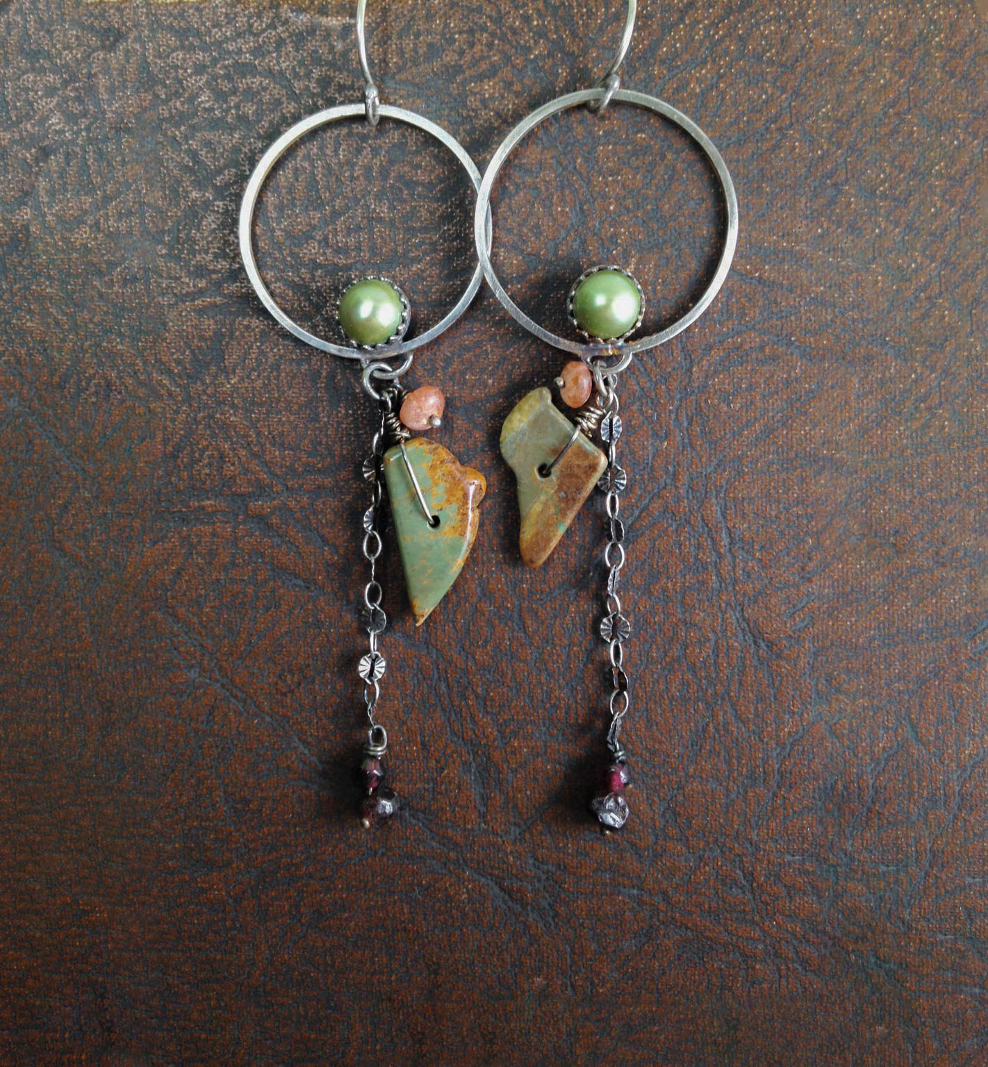 I love these earrings. They are much more beautiful than the photo looks-delicate but also dramatic. These earrings don't weigh a thing and are extremely comfortable in my ears.  -mariposarojo