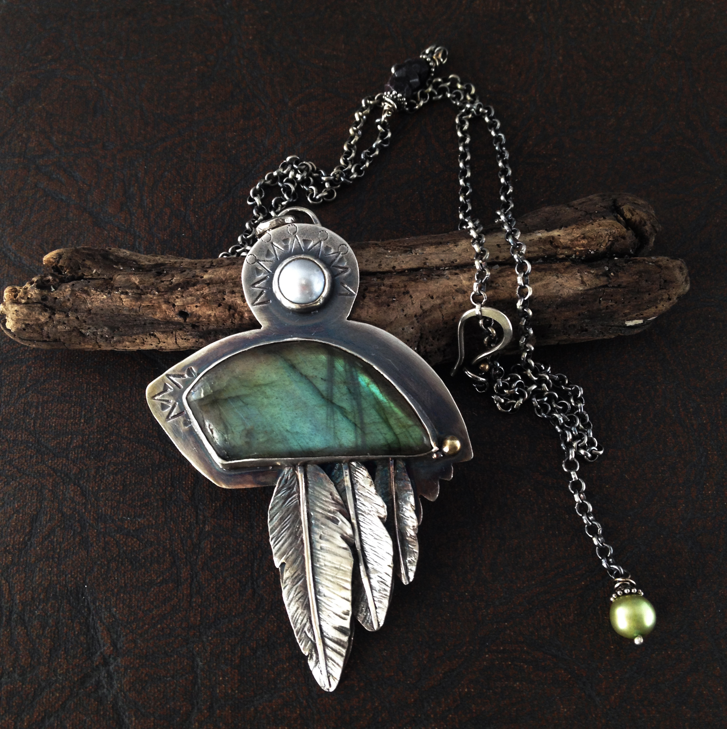 This necklace is so special to me. I love herons and I feel that this pendant truly captures their essence. I enjoy the details along the chain itself and the unique clasp.  -Aspen