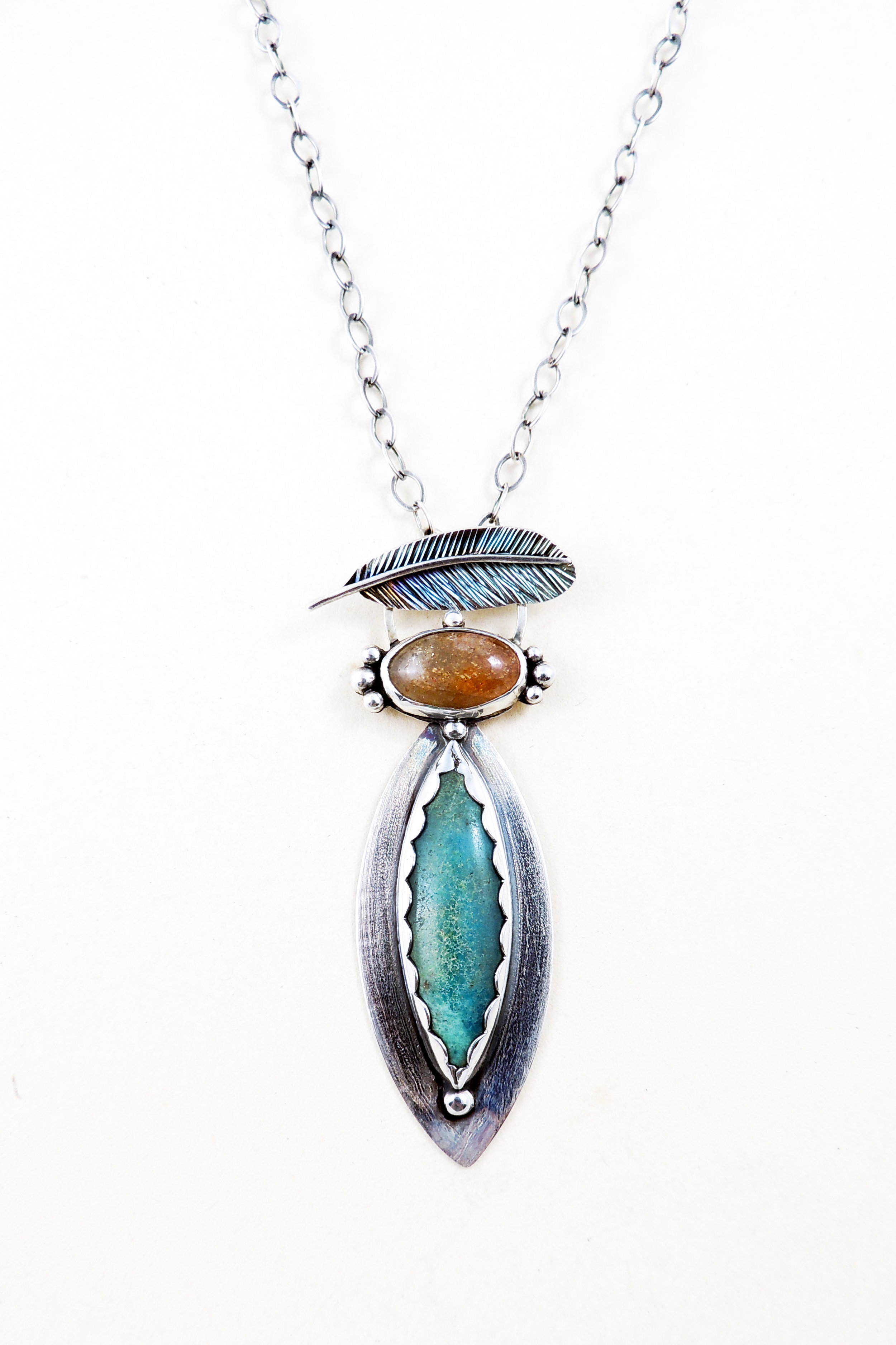 """Very pretty! The stones go together nicely and I love the feather toggle. This is my third """"bird"""" necklace from this artist. They are all unique, evoking their avian inspiration. Artist was very helpful and designed earrings to coordinate with this. Arrived quickly and nicely packaged.  -Christine K"""