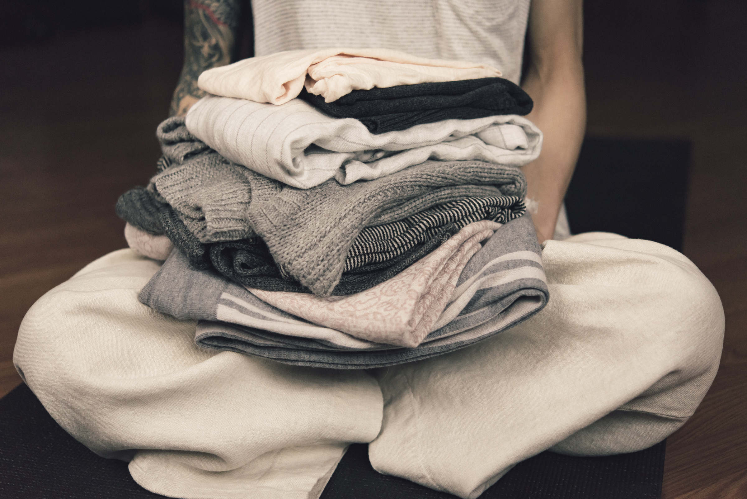 me seated holding clothes.jpg