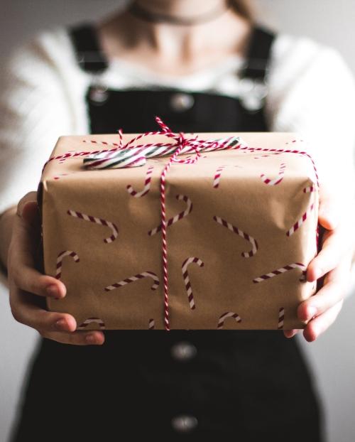 alchemist-eating-girl-holding-gift-christmas.jpg