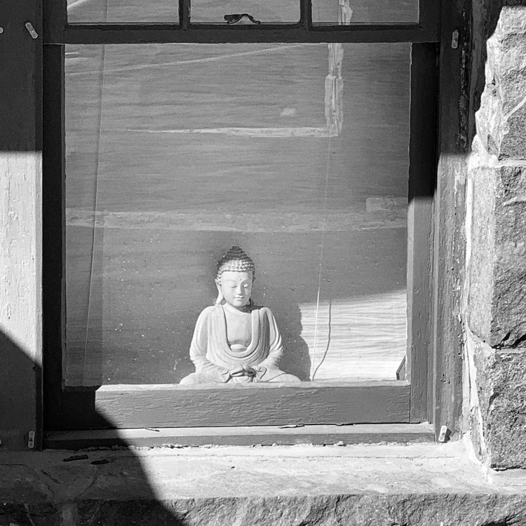 Buddha in a windowsill, Nelson, BC