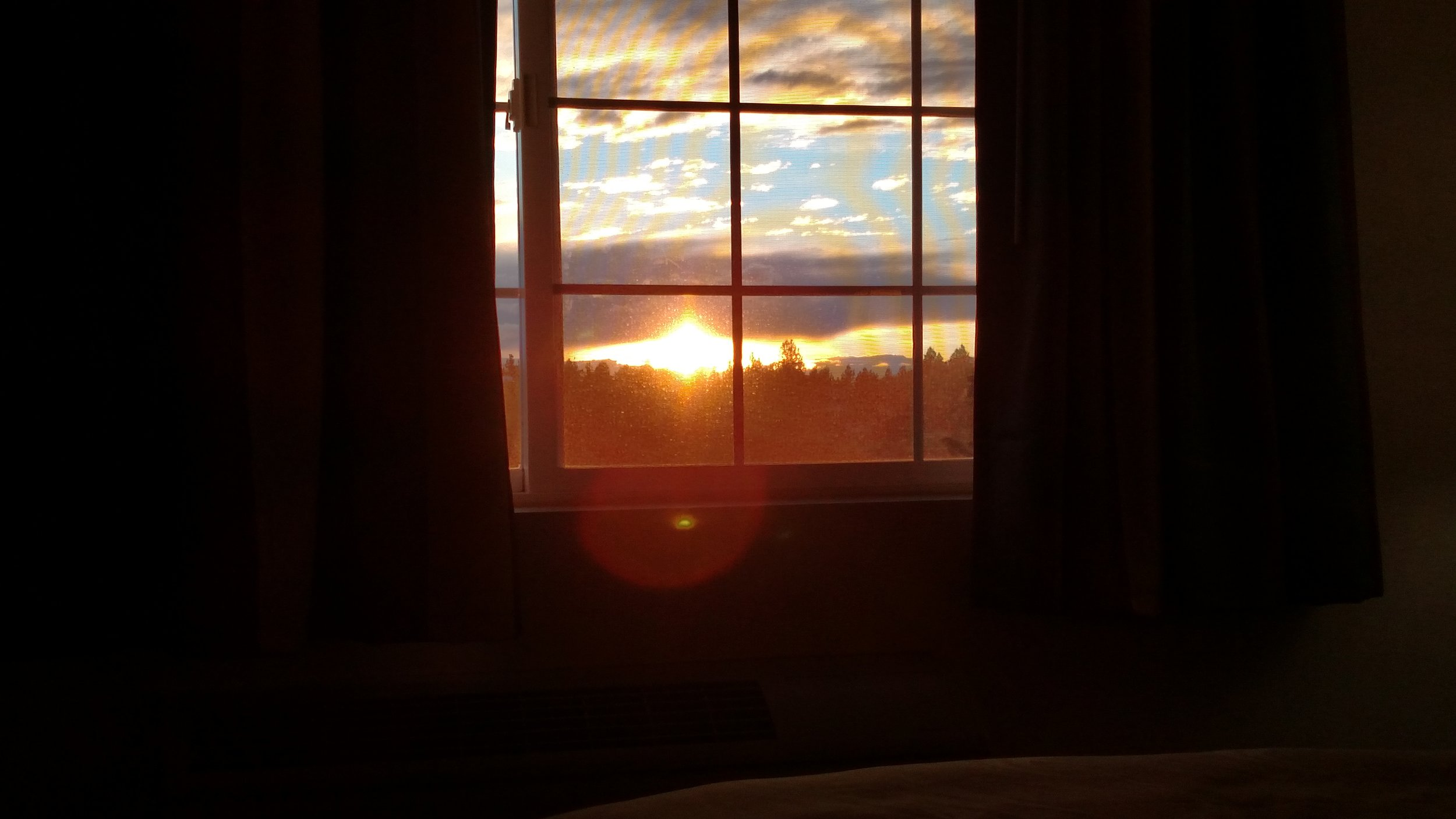 I didn't take a selfie this day, kind of weird because I think I took one every day of the trip up to now. But I did have a nice view of the sunset from my much nicer room at the Quality Inn (I realized later that you could also see The Sisters from my window which was pretty cool.)