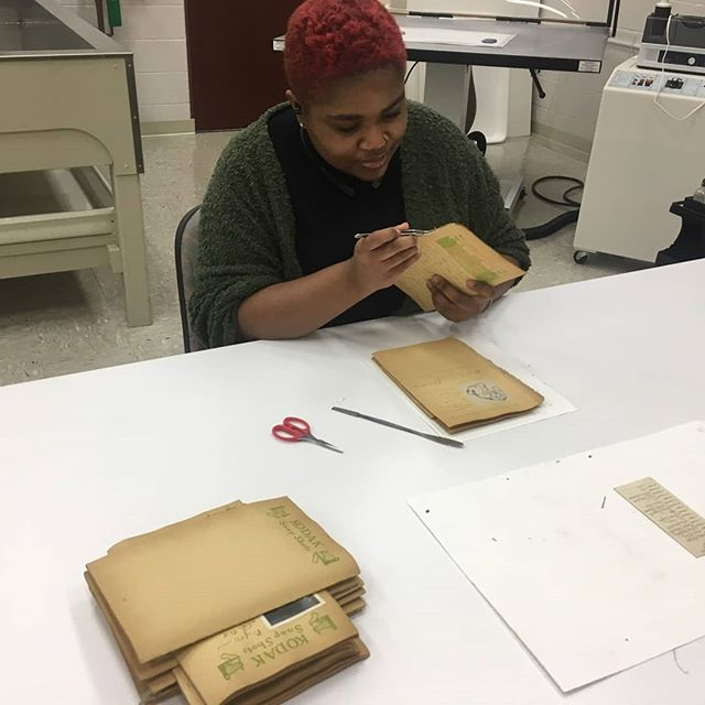 I have been focusing on my art conservation career! Here's me taking out old strings out of book signatures. My interests in conservation are objects, paper, and time based media. There's a good chance I will go to school for time based media conservation.