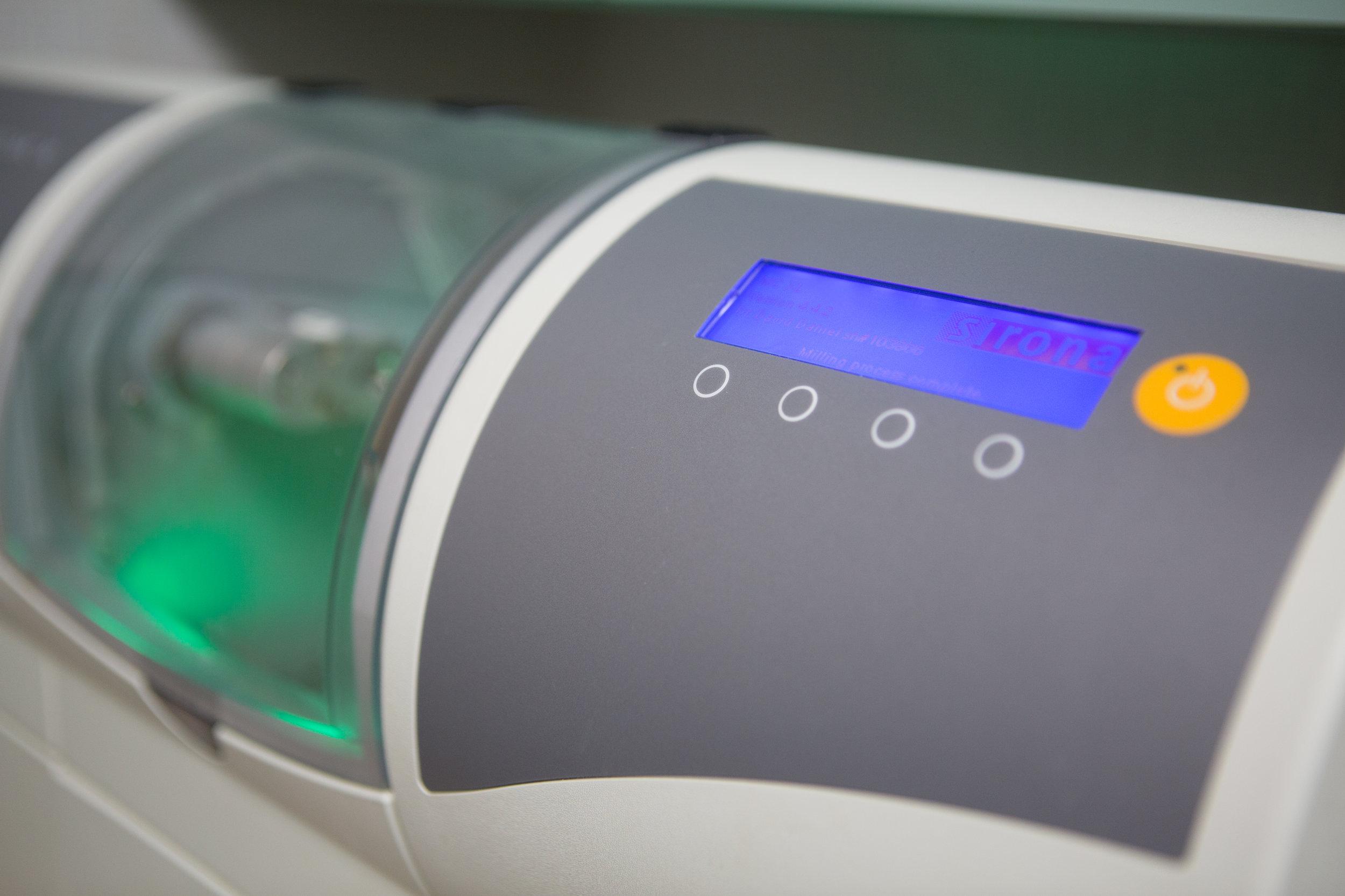Our office's CEREC machine makes permanent crowns will our patients wait.