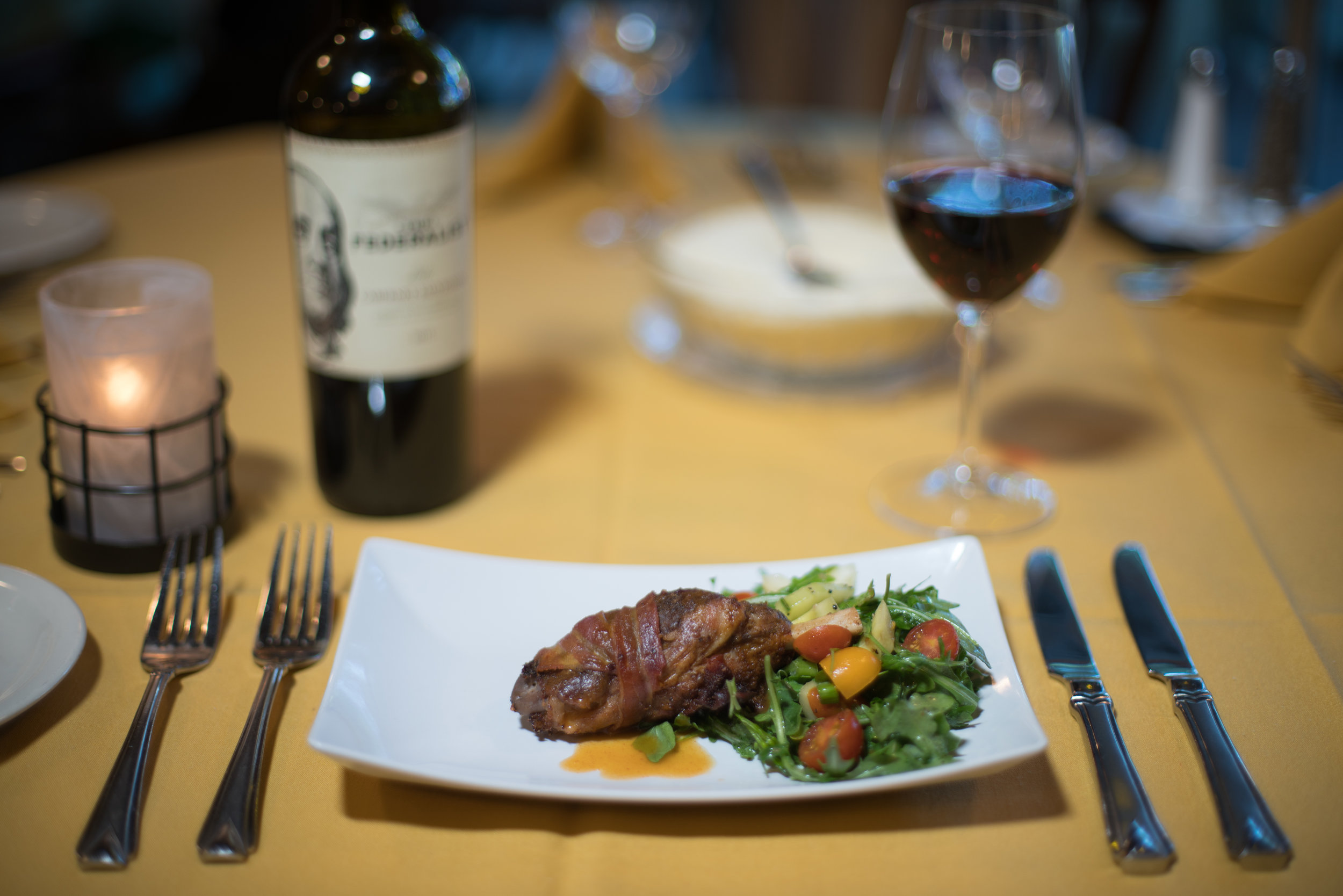 Baby Osso Bucco - Baby pork shank wrapped in pancetta, sautéed and served with spicy mango glaze over arugula salad.