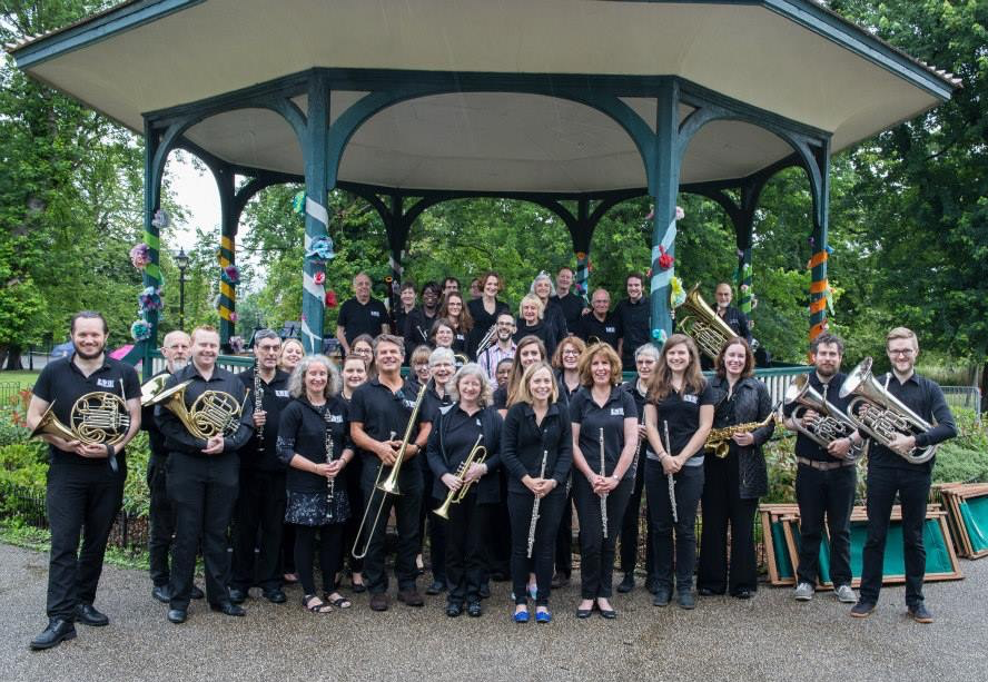 The Lambeth Wind Orchestra with their conductor, John Holland