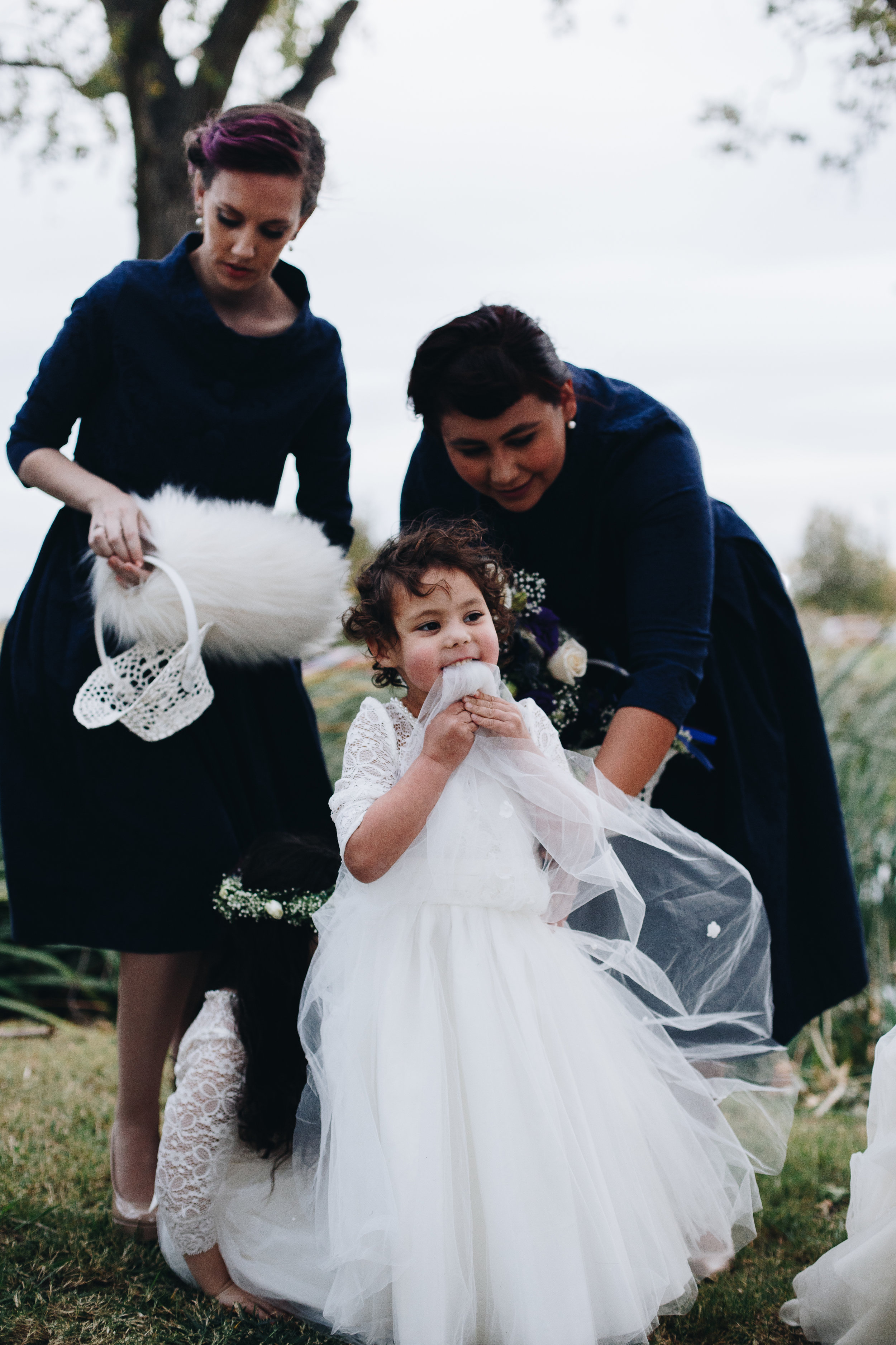 This sweetie flower girl was literally chewing on her dress while the bride and groom were chewing on some communion bread during the ceremony. Shoutout to the Maids of Honor trying to wrangle the two flower girls with the most personality I've ever seen.