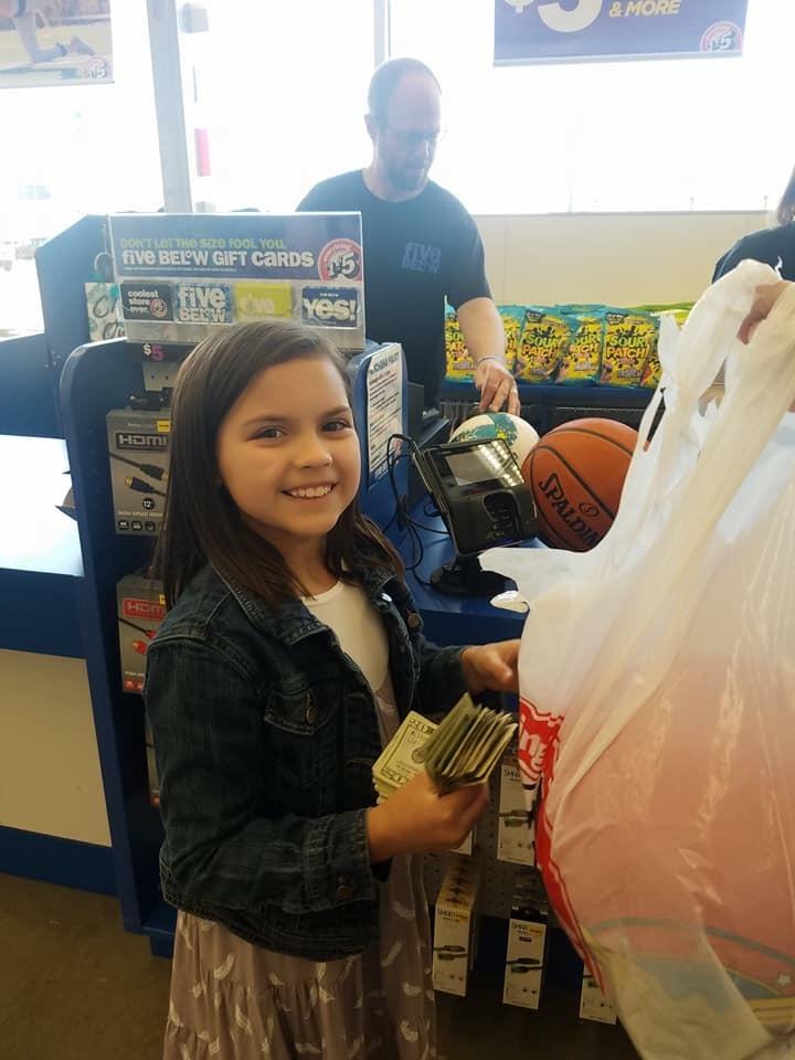 Lovlei shopping for items to donate.JPG