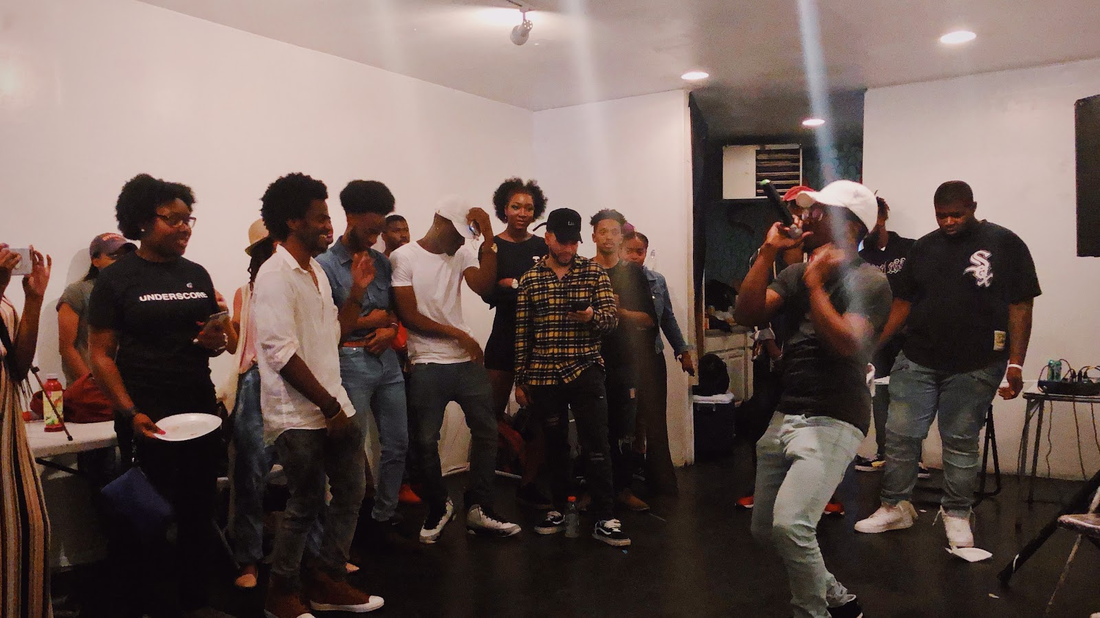 Rapper and singer Gregory Wilson hypes up the crowd and gets them dancing / Voiceless Music Meetup (PHOTO: Regan Hsieh)