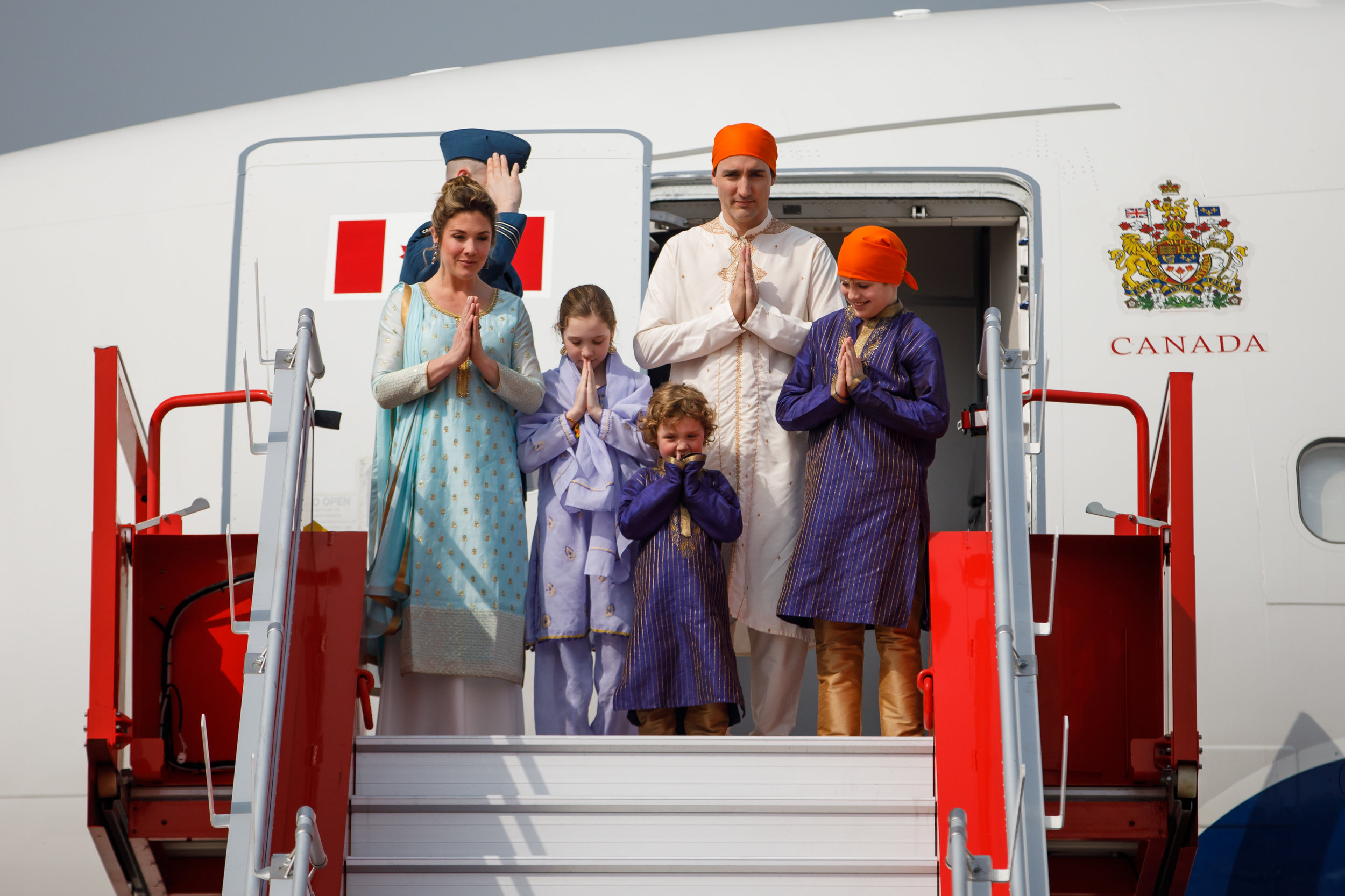 Canadian Prime Minister Justin Trudeau arriving in India with his family in what appeared to be a permanent 'Namaste' pose. Credit: PMO