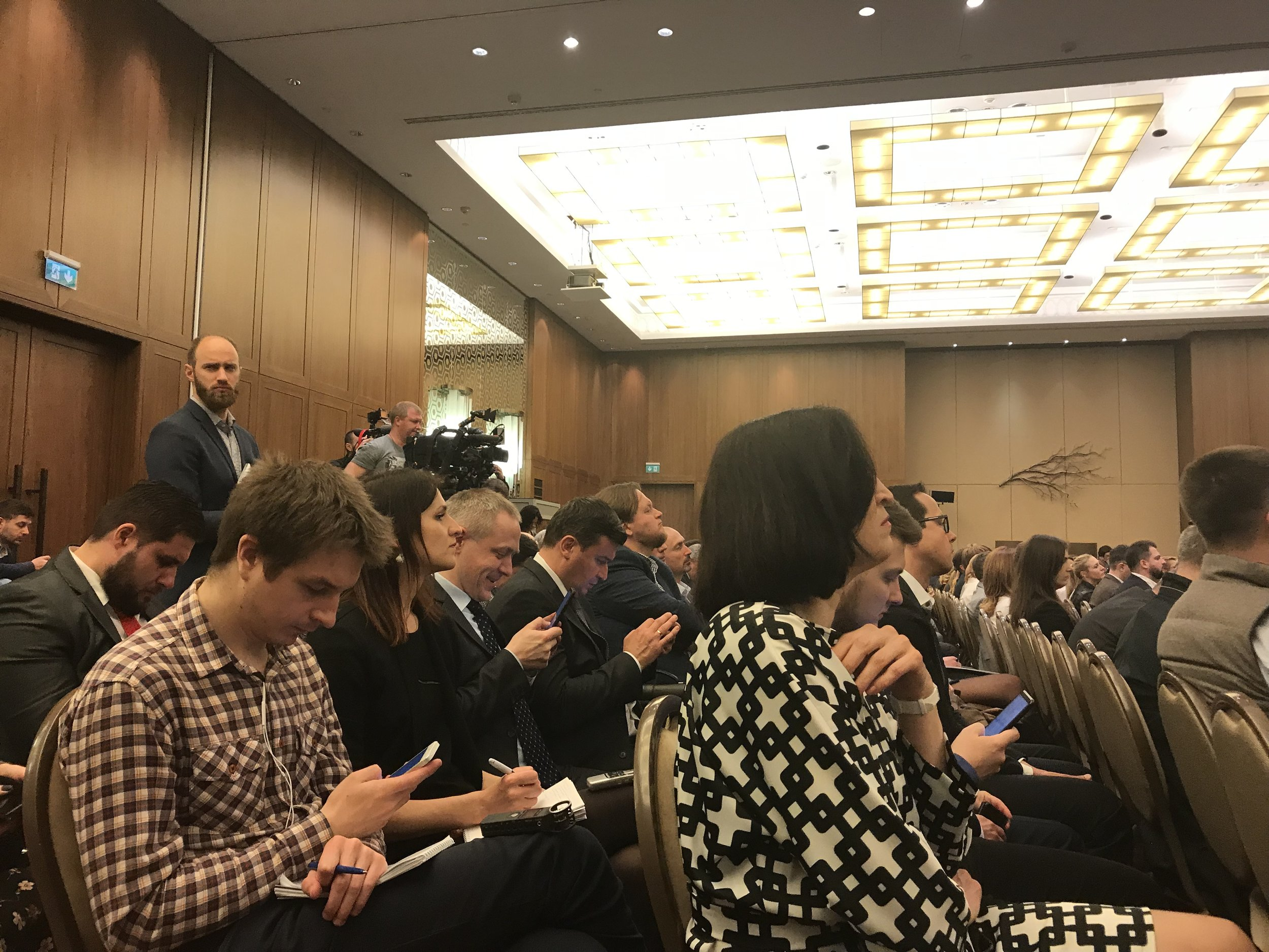 Audience members checking their devices during a panel discussion at the Hilton Hotel Kyiv in April, 2019.