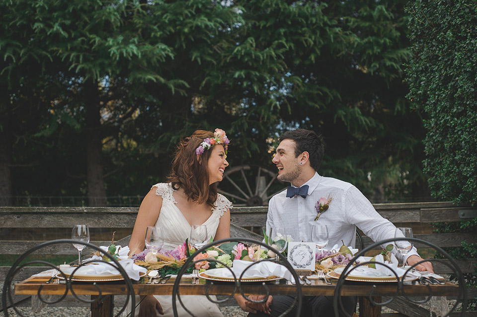 wedding couple at table