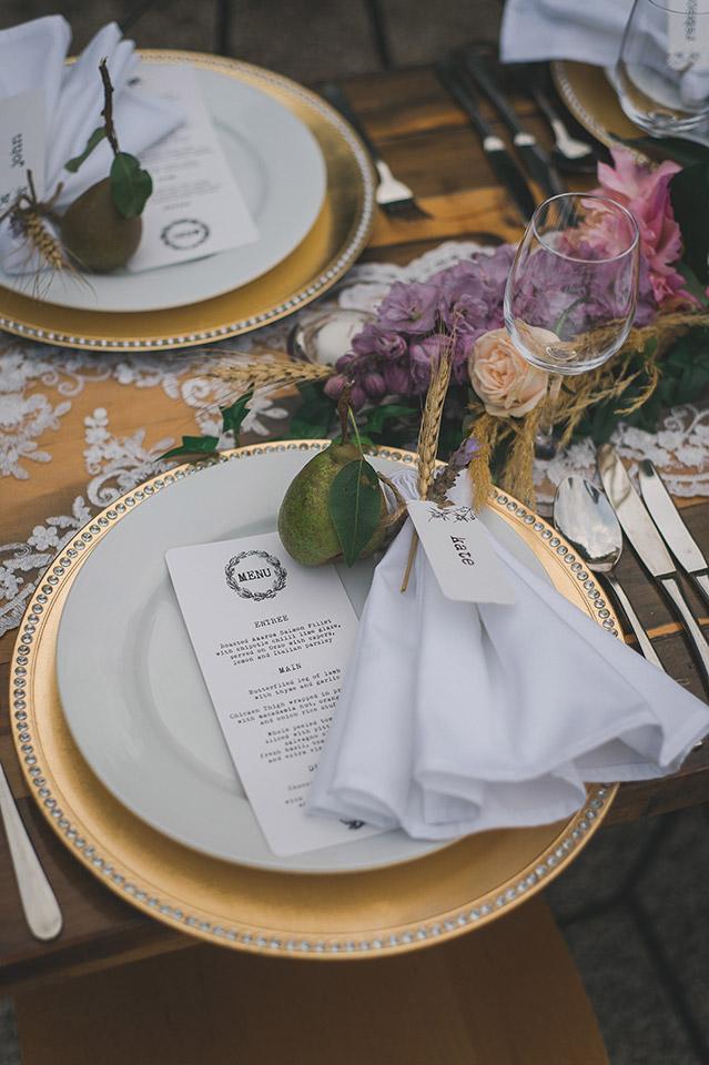 purple gold table setting