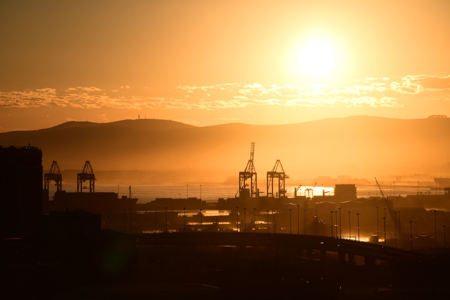 Sunrise over Cape Town's waterfront. Photo courtesy of Adam Yates.