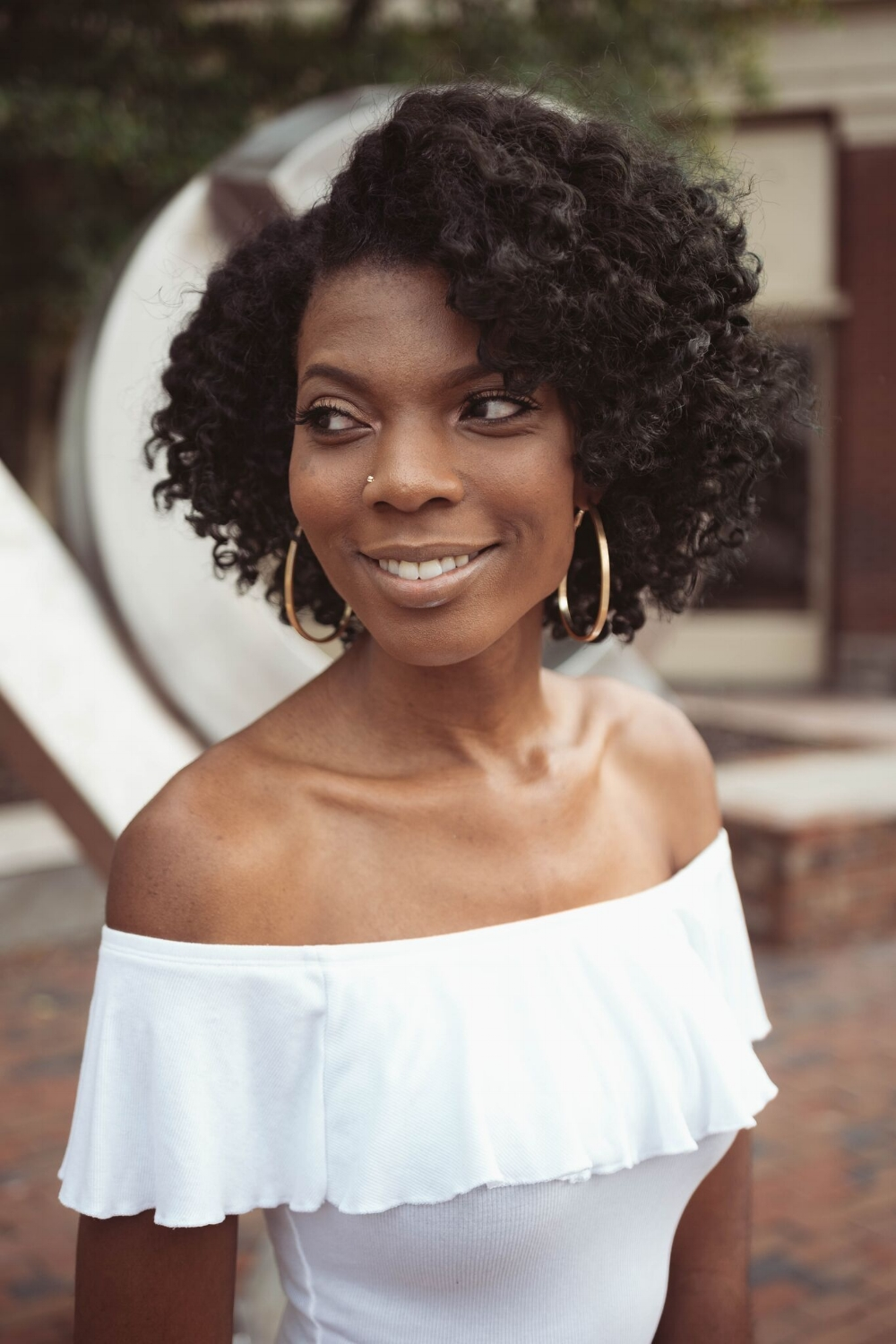 Meet Meelah - Jameelah is the founder of TEXTURE Hair Care (THC) of Fayetteville, NC, who considers herself a curl consultant and coach. She is both an alumni of Fayetteville State University and Paul Mitchell the School with a bachelors in Accounting and Cosmetology, respectively. Meelah has close to a decade of experience in the natural hair care world and is dedicated to encouraging, empowering and educating women with curls. From coloring to cutting and back to styling, she takes great pride in not only staying current with new trends but pushing the envelope on what natural hair can be, all while focusing specifically on the integrity and health of the hair.