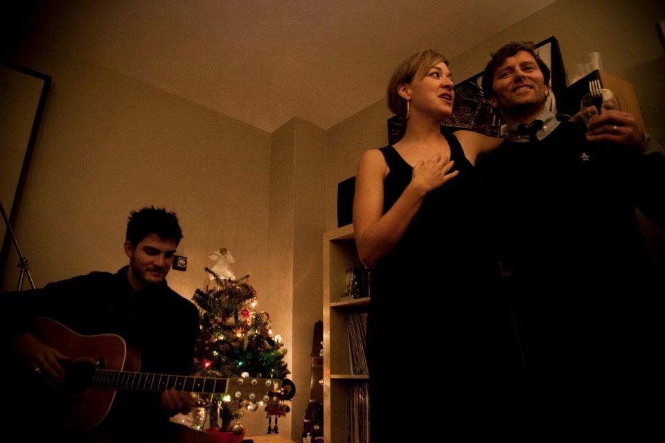The wonderful  Grant Lawrence wrote a post on his blog about selling his old apartment in English Bay . Part of it was about having musicians play his annual Christmas party, and I loaned him some of the photos that I took there.   Above is Grant and Jill, with Mr Dave Vertesi from the last xmas party in the apartment.   I'll miss yelling up at the balcony after a movie in Stanley Park…