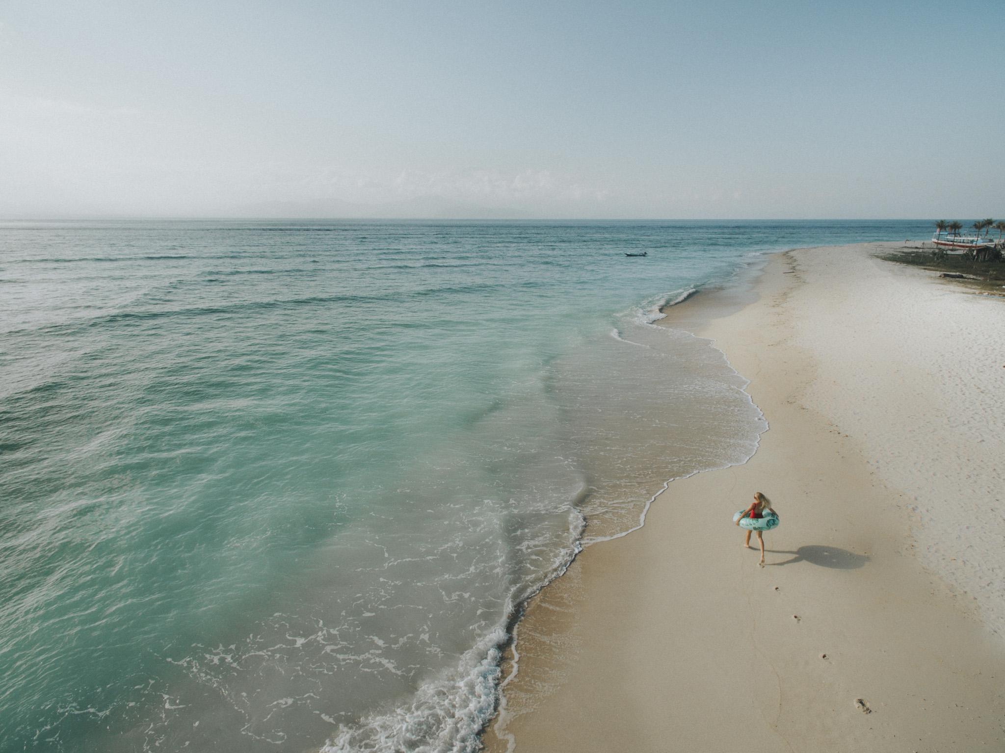 Swimming in Nusa Lombongan turquoise ocean