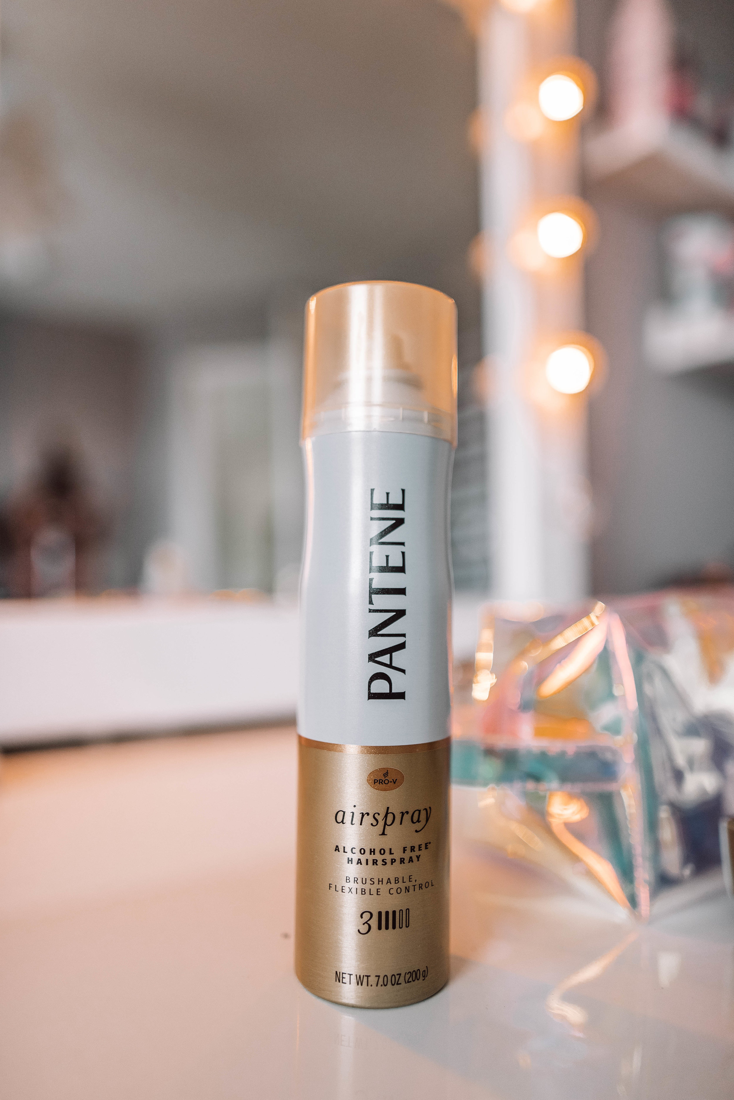 Pantene's Airspray - Not only does Pantene's Airspray act as a hairspray by providing a strong hold, but it also locks out humidity, adds shine, and controls frizz. This can be used to set your look in place before you head out and can also be used to touch up throughout the day! Oh, and did I mention it's alcohol-free?