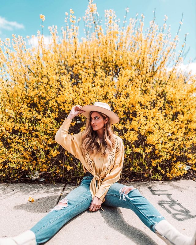 Bloom baby, bloom 🌼 This super cute top is from @andotherstories 💛 I have linked all outfit details on the LIKEtoKNOW.it app for you guys to shop!  I found this huge floral bush in the center of downtown Indy off the side of a busy street!! The world is full of spring vibes right now and I am living for it😍 http://liketk.it/2Bcm7 #liketkit @liketoknow.it #LTKspring