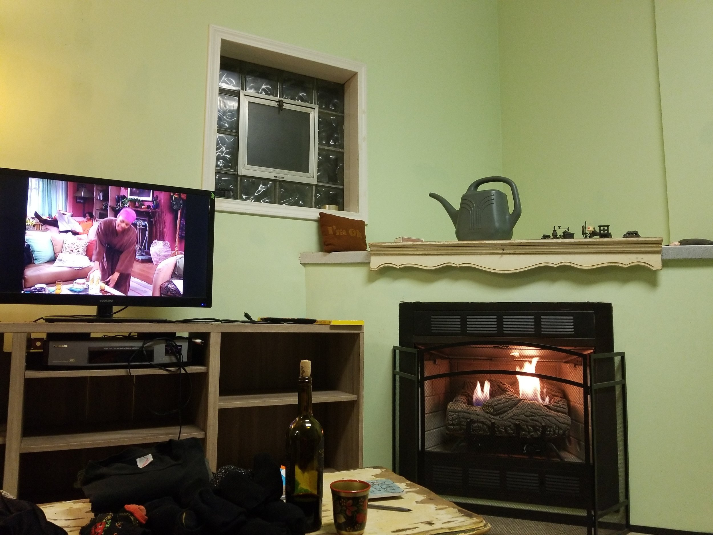 Our gas fireplace :) (I was watching  Living Single  and drinking wine while I did my laundry. Officially bougie.)