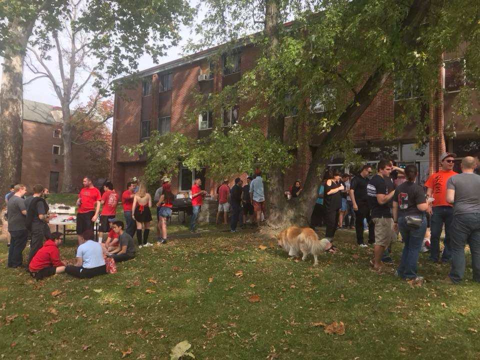 Actives and Alumni Enjoying Homecoming Tailgate at the Shelter