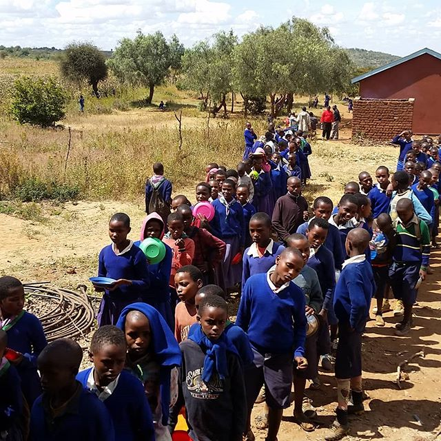 Students lined up for lunch at Gijega Primary School. #schoollunchprogram #Tanzania #africanonprofit #hungrykids