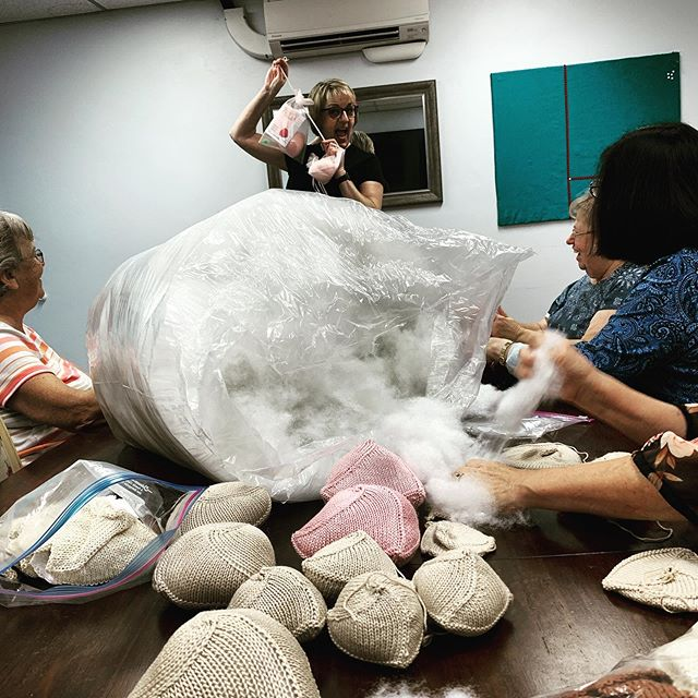 Our #knittedknockers stuffing party is well underway! @knittedknockers supplies comfortable, hand-knit breast prosthetics to mastectomy recipients free of cost. We're proud to support this movement!