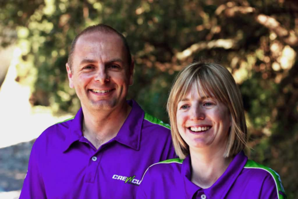 Happy Crewcut couple lawn business owners
