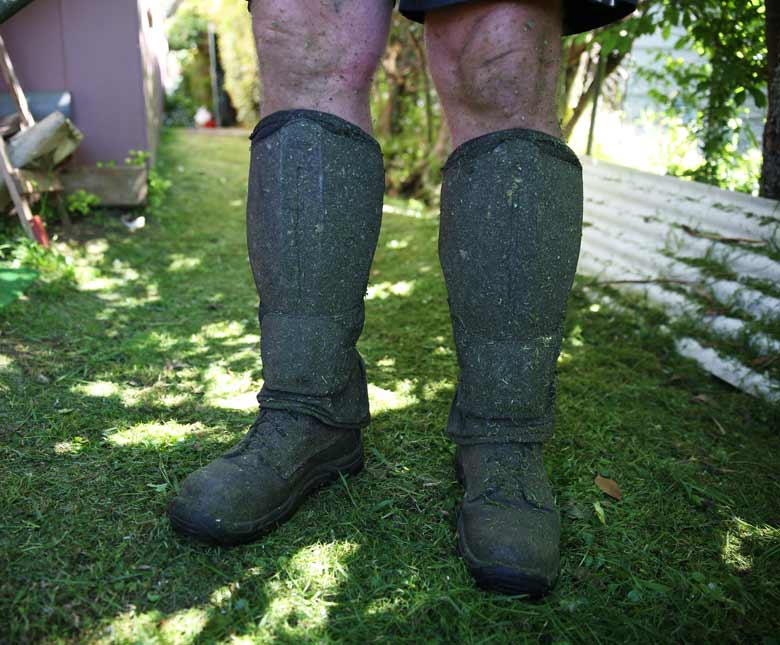 Boots covered in grass clippings
