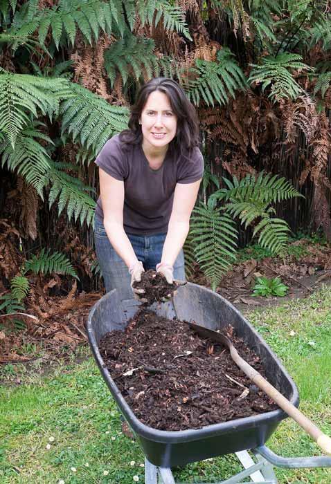 Kiwi lady with fertiliser in wheelbarrow