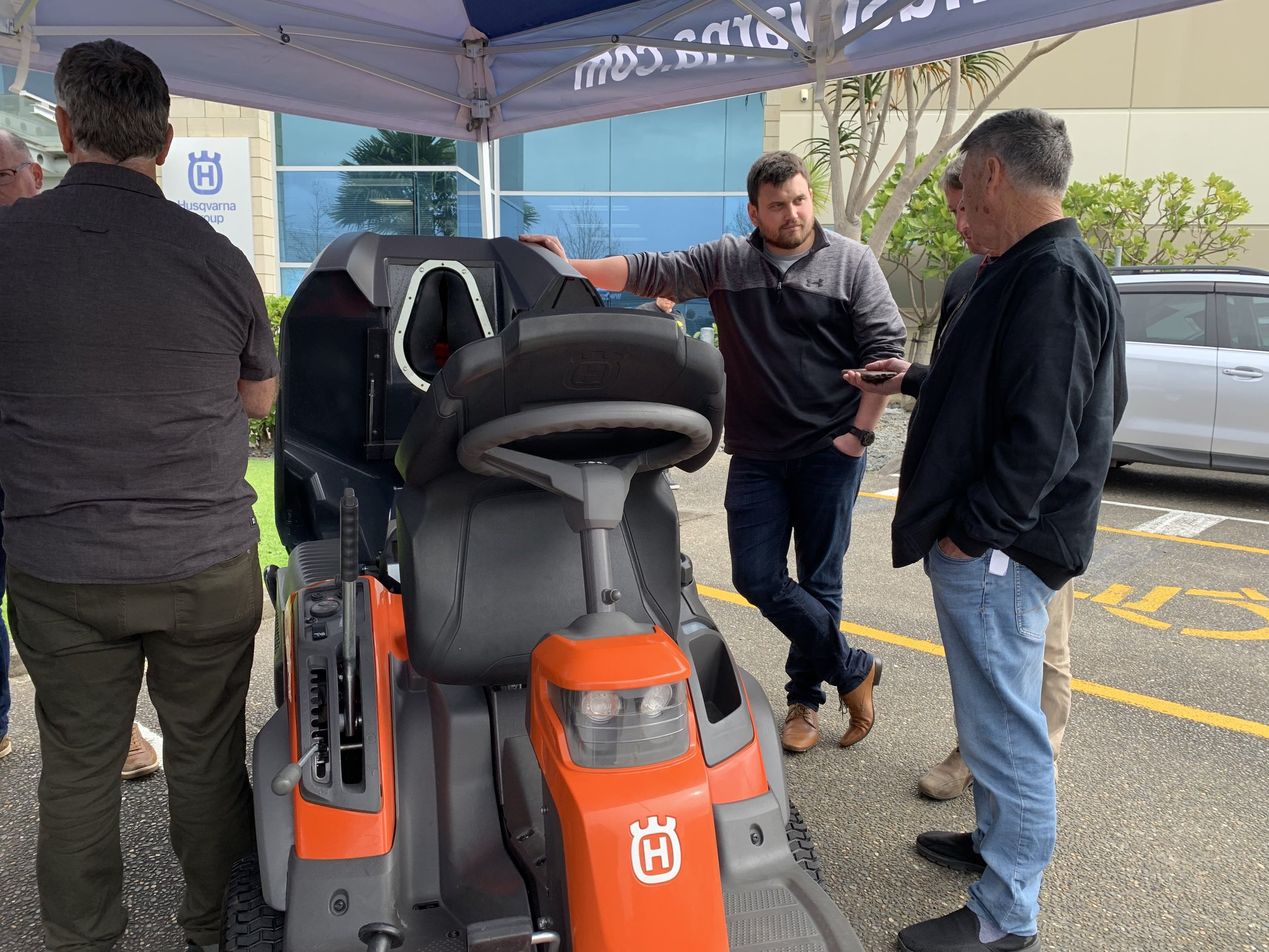 Crewcut regional masters checking out the Husqvarna ride-on mowers