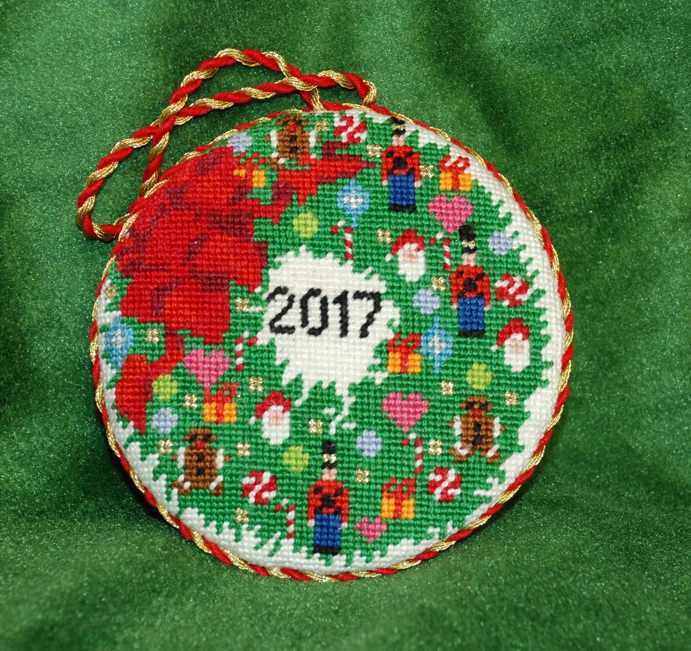 2017 KC Needlepoint Ornament of the Year specially designed for the store. This ornament has regular stitches, but a class was held to use fancy stitches for those who wanted an even more ornate design.