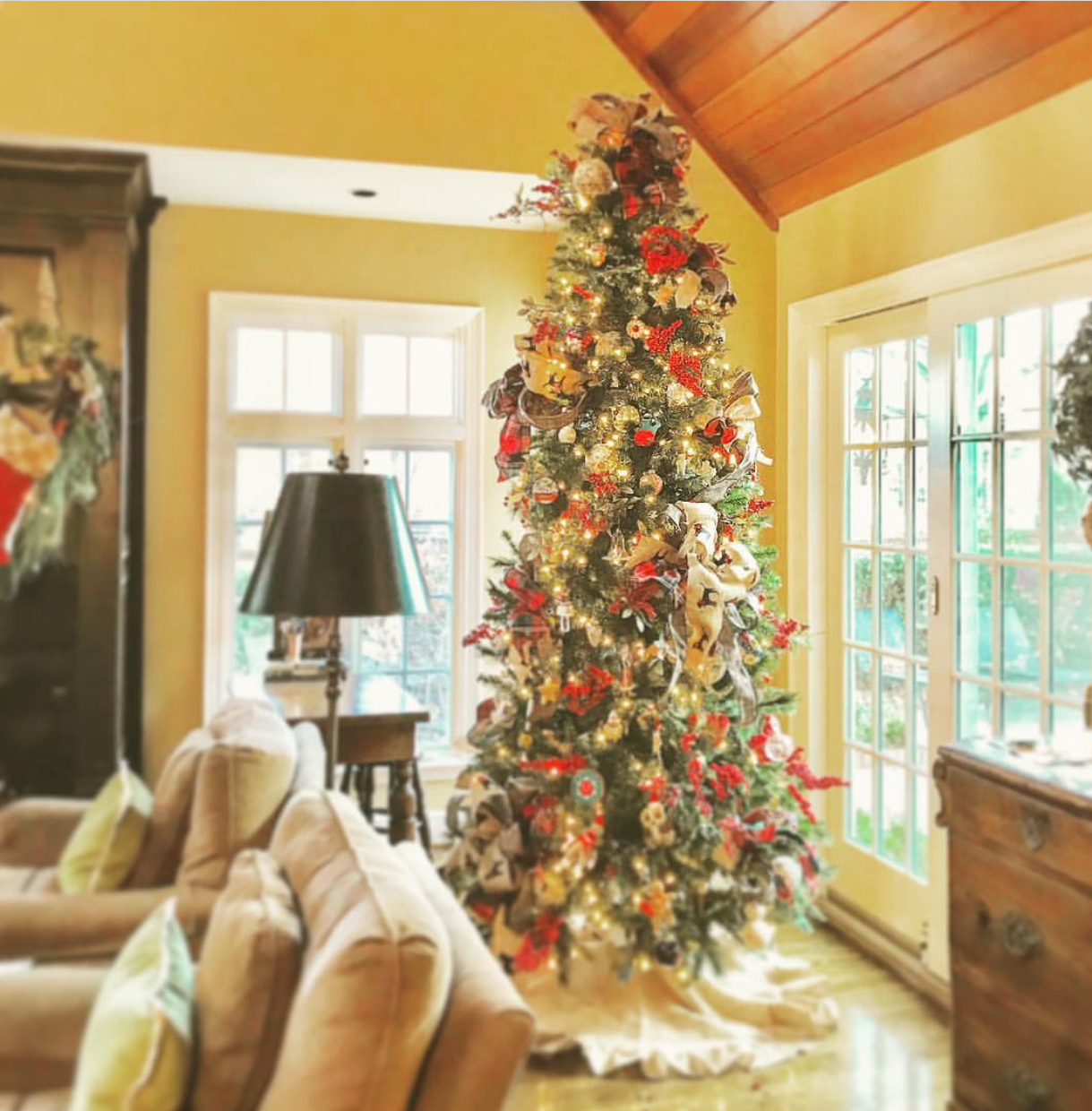 Our family room tree has such a wide variety of ornaments that are special to our family - everything from homemade ornaments by our children to drill team ornaments to my grandmother's handmade angel ornaments to ornaments of our dogs to special ornaments passed down through the years from family.