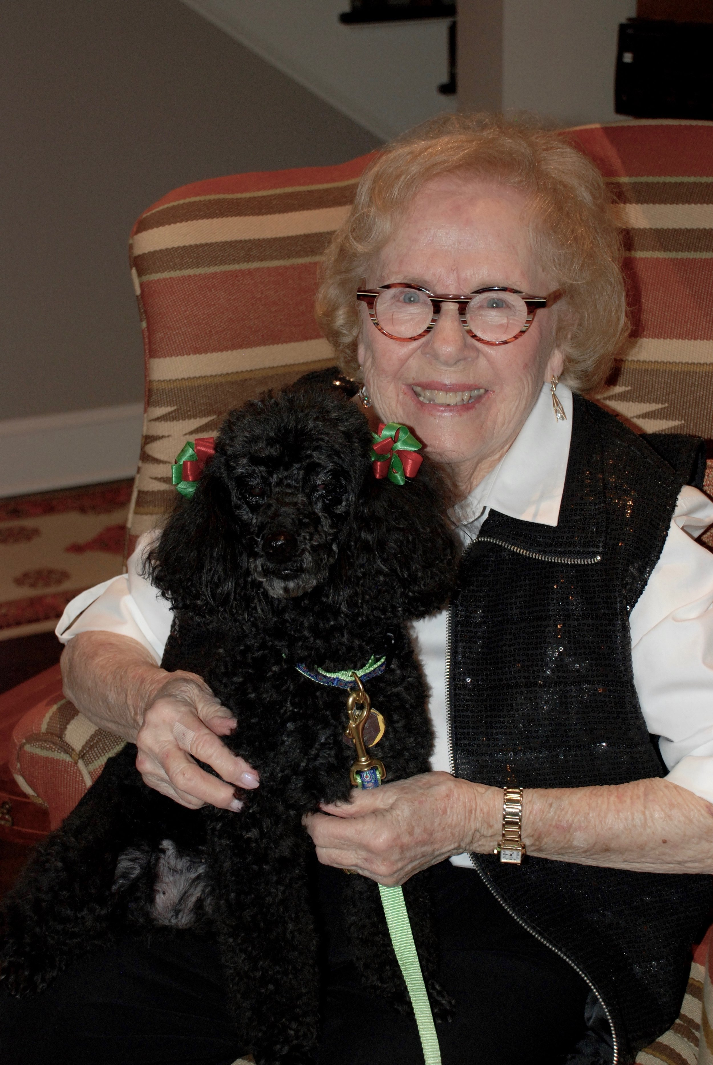 My mother with her dog, Bella. Angel food cake with strawberries and whipped cream is one of her specialties.