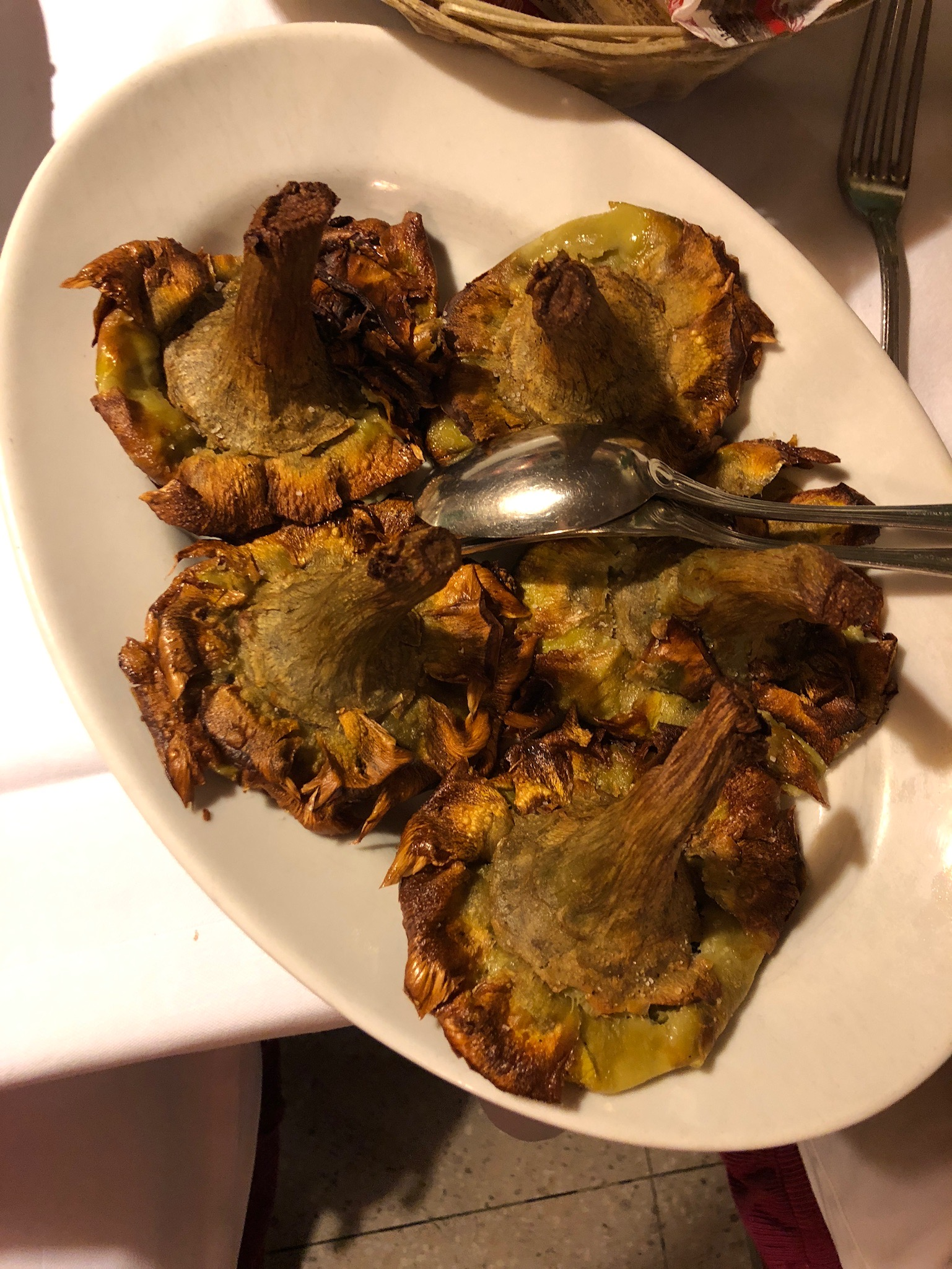 One of the most classic appetizers in Rome that you can find in restaurants or sold by the street vendors is fried artichoke flowers. We were unsure if it was customary to eat the entire thing, stems and all. But we had no problem eating it! So delicious and also not a common way to cook artichokes in U.S. establishments.