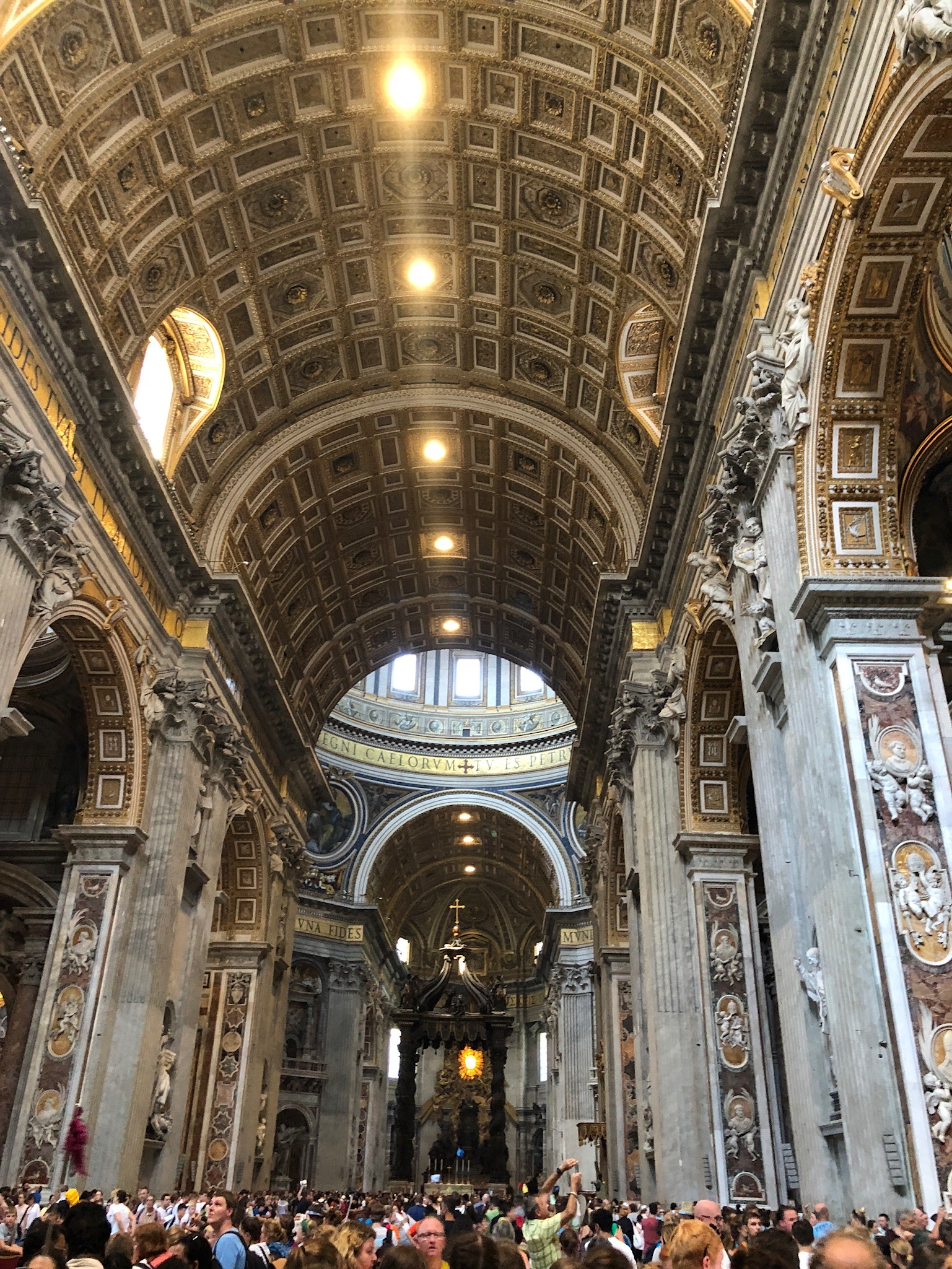St. Peter is said to be buried below this cathedral named after him where only the Pope can perform mass under the bronze structure in the middle of the cathedral.