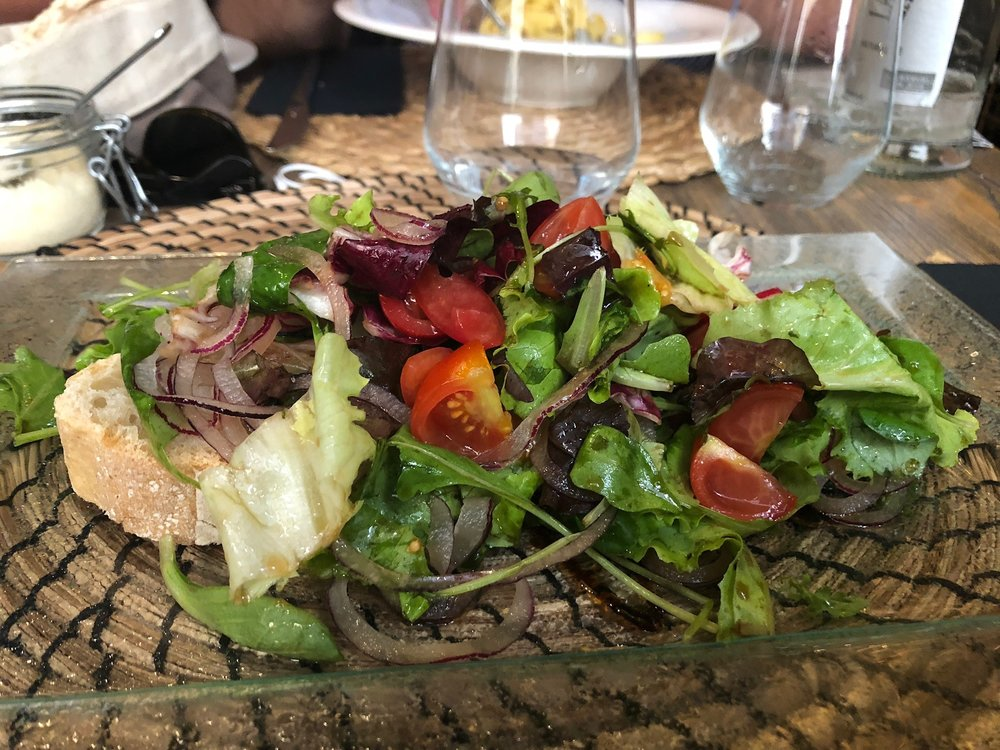 A relief to all the pasta we had been eating, I ordered this delicious tossed salad. They served it atop crusty homemade bread.